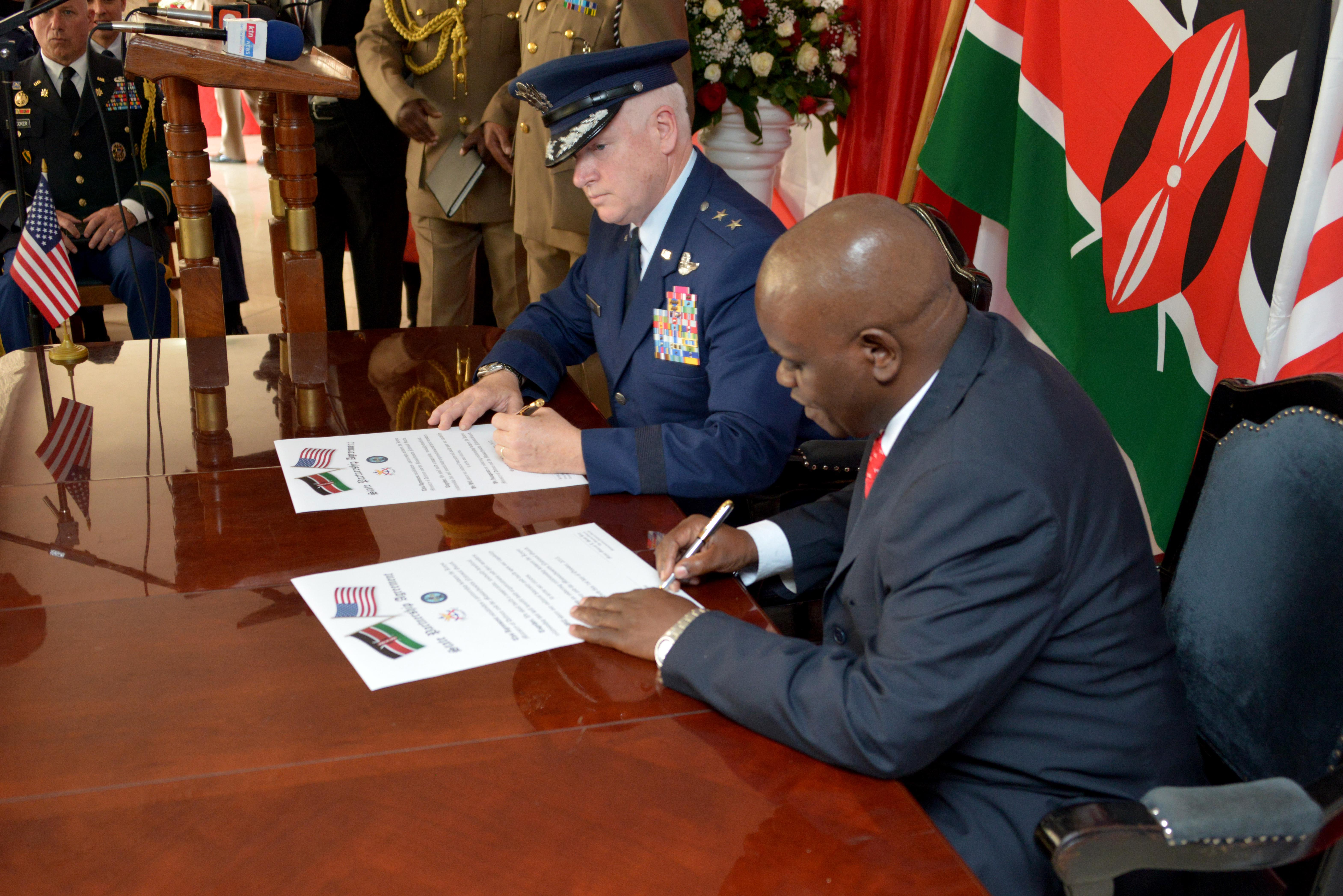 Maj. Gen. L. Scott Rice, the adjutant general, Massachusetts National Guard, and Kiritu Miano Wamae, acting principal secretary, Kenya Ministry of Defence, sign the state partnership agreement  between the Republic of Kenya and the Massachusetts National Guard during a ceremony held at the Ministry of Defence here, Oct. 1, 2015. (U.S. Amy National Guard Photo by 1st Sgt. Don Veitch/Released)