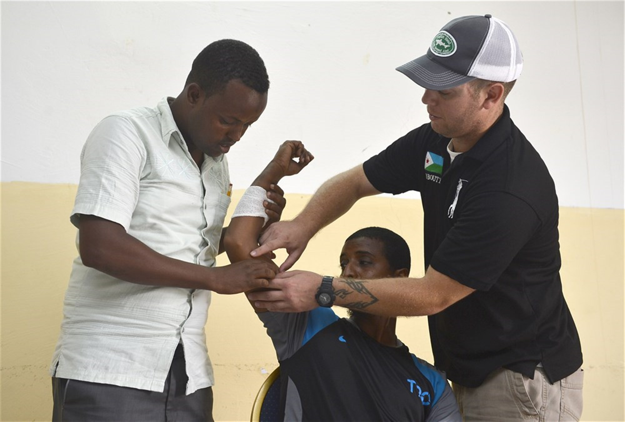 U.S. Army Staff Sgt. Joshua Domalski, Civil Affairs Battalion specialist and medic, right, demonstrates first aid procedures for community health workers in Obock, Djibouti, Oct. 17, 2015. The U.S. Army Civil Affairs Bn, assigned to Combined Joint Task Force-Horn of Africa, held a community health worker course, during which instructors taught basic preventative medicine measures, first aid, oral hygiene care, and the health hazards of female genital mutilation.
