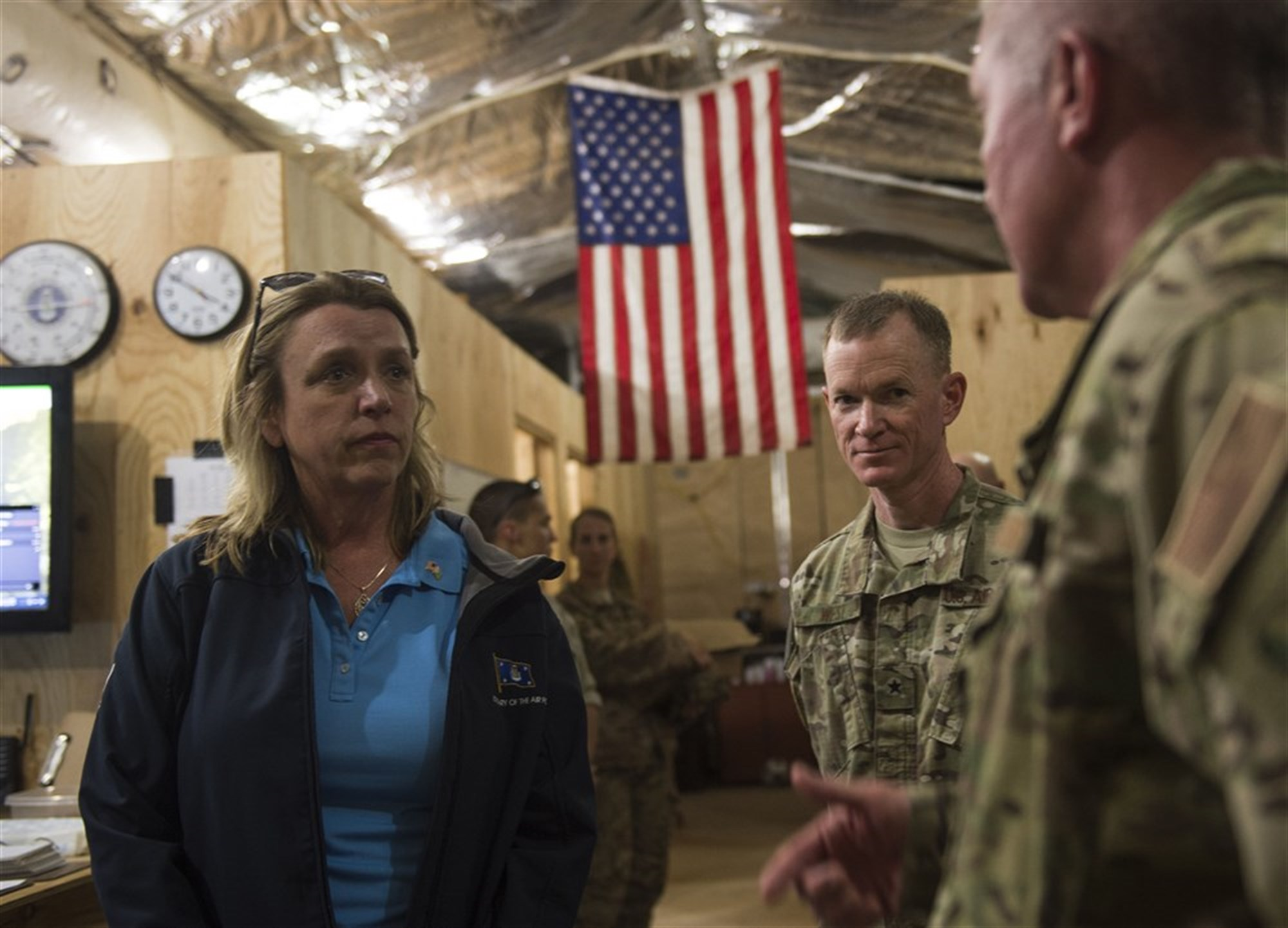 Secretary of the Air Force Deborah Lee James speaks with U.S. Air Force Col. Daniel Duffy, 449th Air Expeditionary Group commander, at Chebelley Airfield, Djibouti, Nov. 12, 2015. James met with many Airmen who work to sustain the mission in remote parts of the country. (U.S. Air Force photo by Senior Airman Peter Thompson)