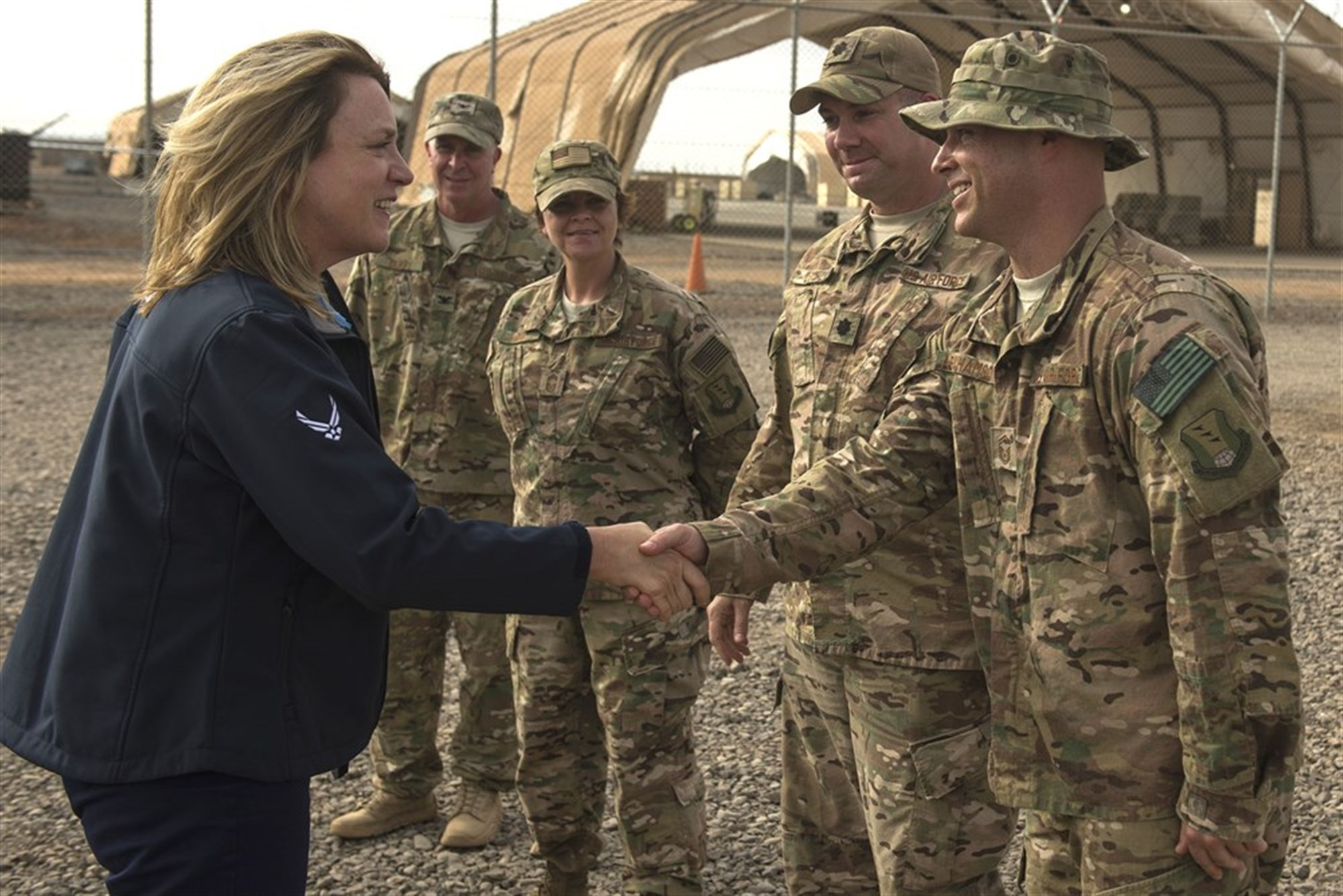 Secretary of the Air Force Deborah Lee James greets Chebelley Airfield leadership, Nov. 12, 2015. During her visit to Chebelley and Camp Lemonnier, James interacted with Airmen across a wide spectrum of career fields as she learned about the critical operations in each location.