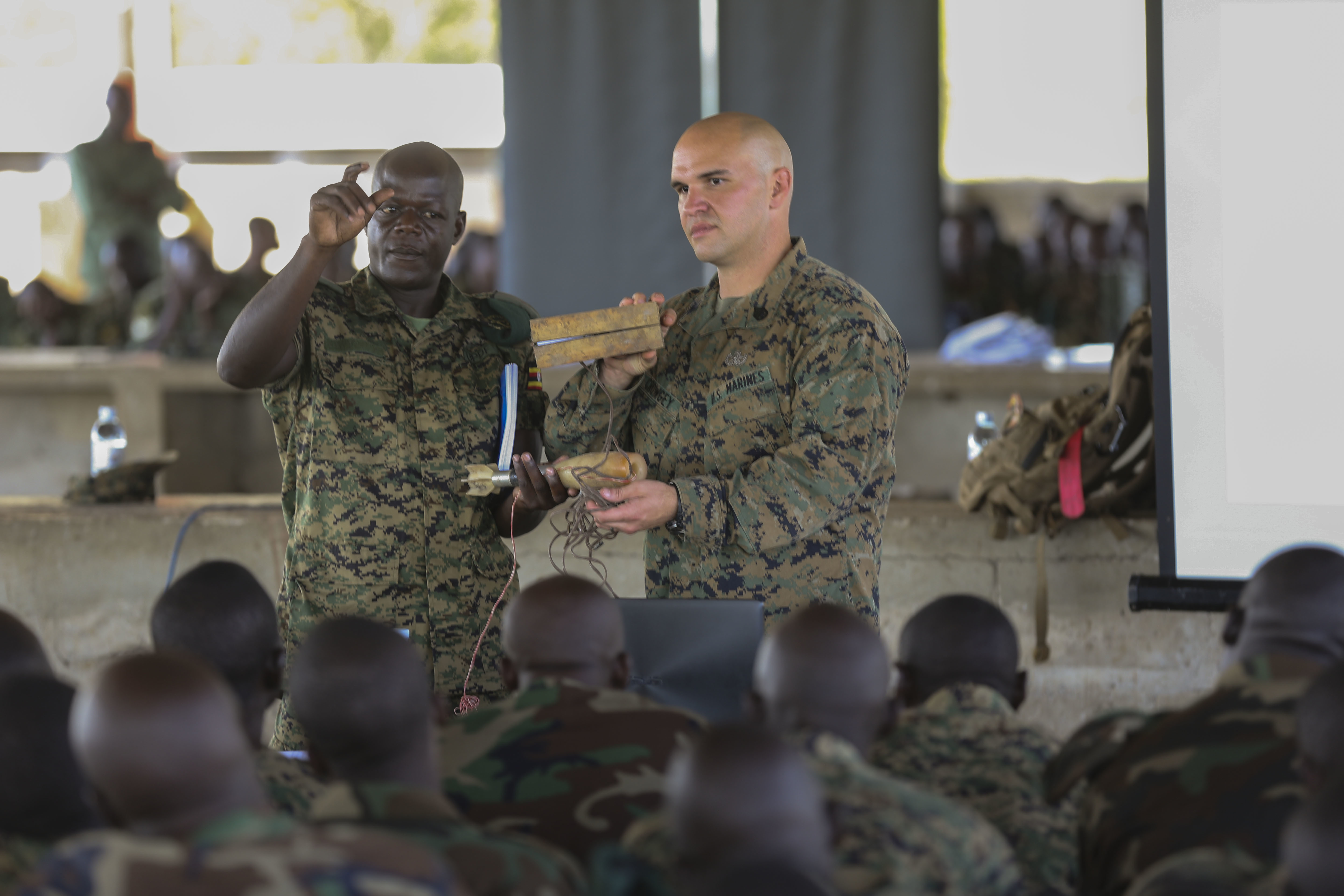 U.S. Marine Staff Sgt. Evan Crowgey, an explosive ordnance disposal technician with Special-Purpose Marine Air-Ground Task Force Crisis Response-Africa, conducted an improvised explosive device awareness class with the Uganda People's Defense Force at Camp Singo, Uganda, Nov. 2, 2015. Marines and sailors with SPMAGTF-CR-AF are training with the UPDF to increase engineering and logistical capabilities while strengthening the bonds between the partner counties. (U.S. Marine Corps photo by Cpl. Olivia McDonald/Released)