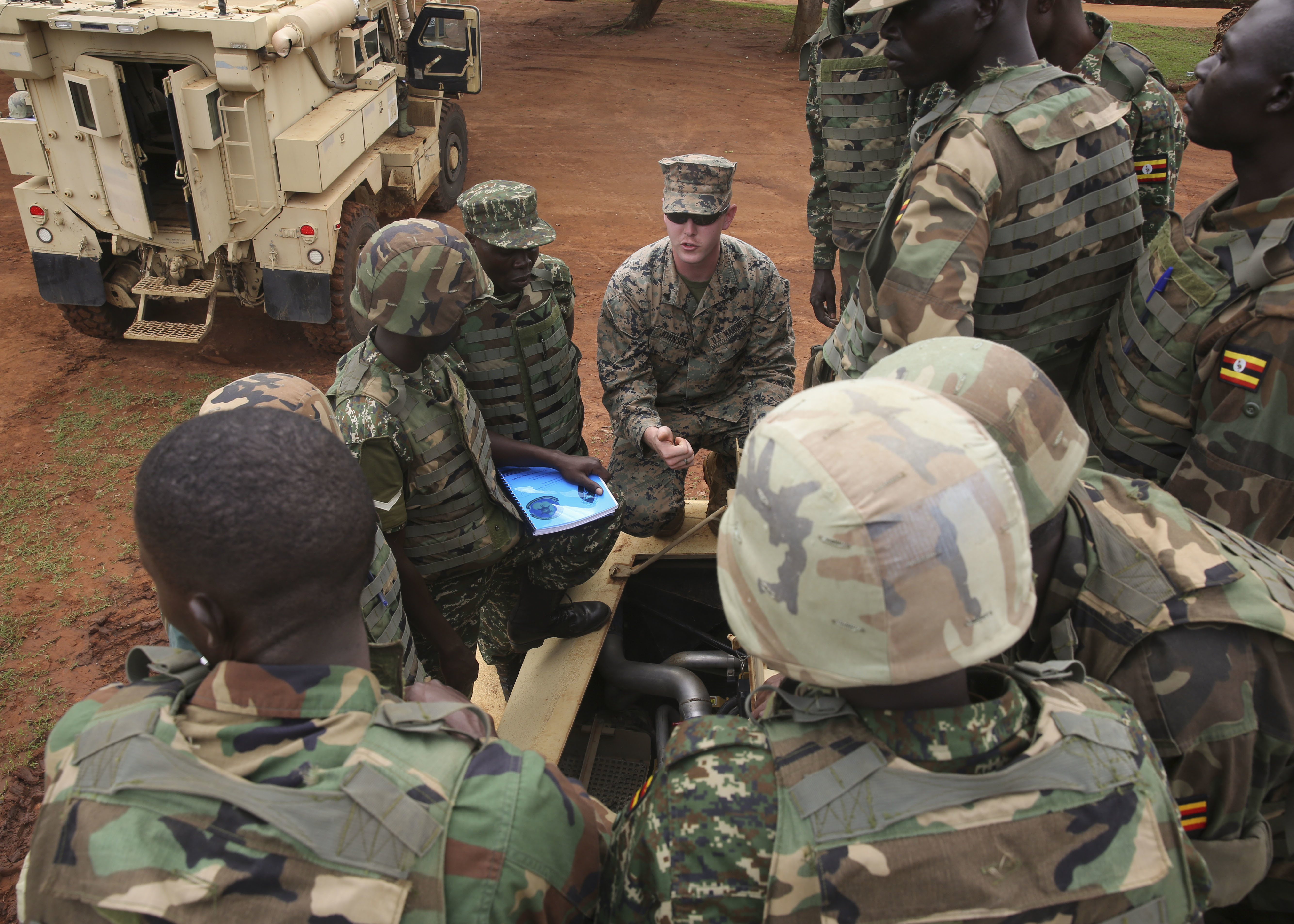 U.S. Marines with Special-Purpose Marine Air-Ground Task Force Crisis Response-Africa, train members of the Uganda People's Defense Force on Mine-Resistant, Ambushed-Protected Vehicles, or MRAPs, at Camp Singo, Uganda, Nov. 3, 2015. Marines and sailors with SPMAGTF-CR-AF are training with the UPDF to increase engineering and logistical capabilities while strengthening the bonds between the partner countries. (U.S. Marine Corps photo by Cpl. Olivia McDonald/Released)
