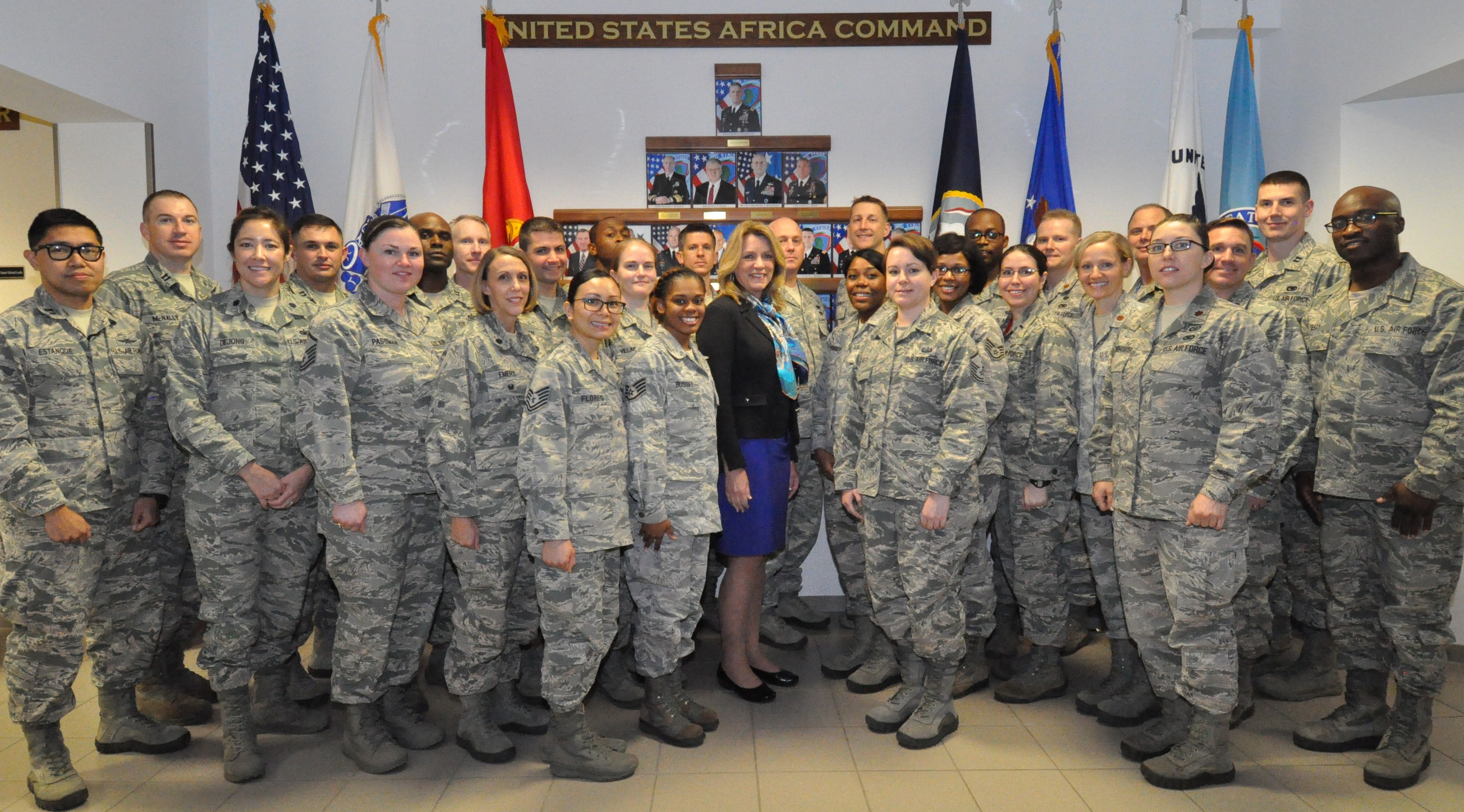 Secretary of the Air Force Deborah Lee James poses with select Airmen stationed in Stuttgart, Germany, Nov. 18, 2015. The Secretary's visit to U.S. Africa Command concluded with an Airmen's Call where she discussed her top priorities for the Air Force. (U.S. Africa Command photo by Brenda Law/RELEASED)