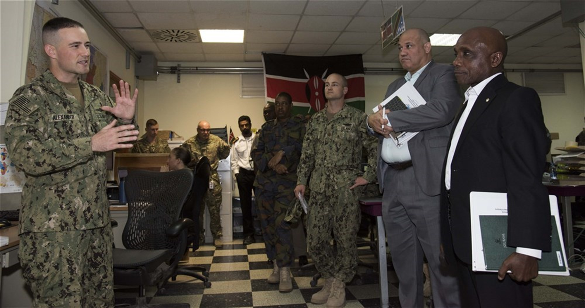Ambassador Issimail Chanfi, director of the Eastern Africa Standby Force, right, receives an introduction to the Fusion Action Cell at Camp Lemonnier, Djibouti, Oct. 27, 2015. The FAC is comprised of service members from the U.S., Europe and East Africa working together to setup military-to-military projects and civilian support initiatives in partner countries throughout the Horn of Africa. (Combined Joint Task Force-Horn of Africa photo/Released)