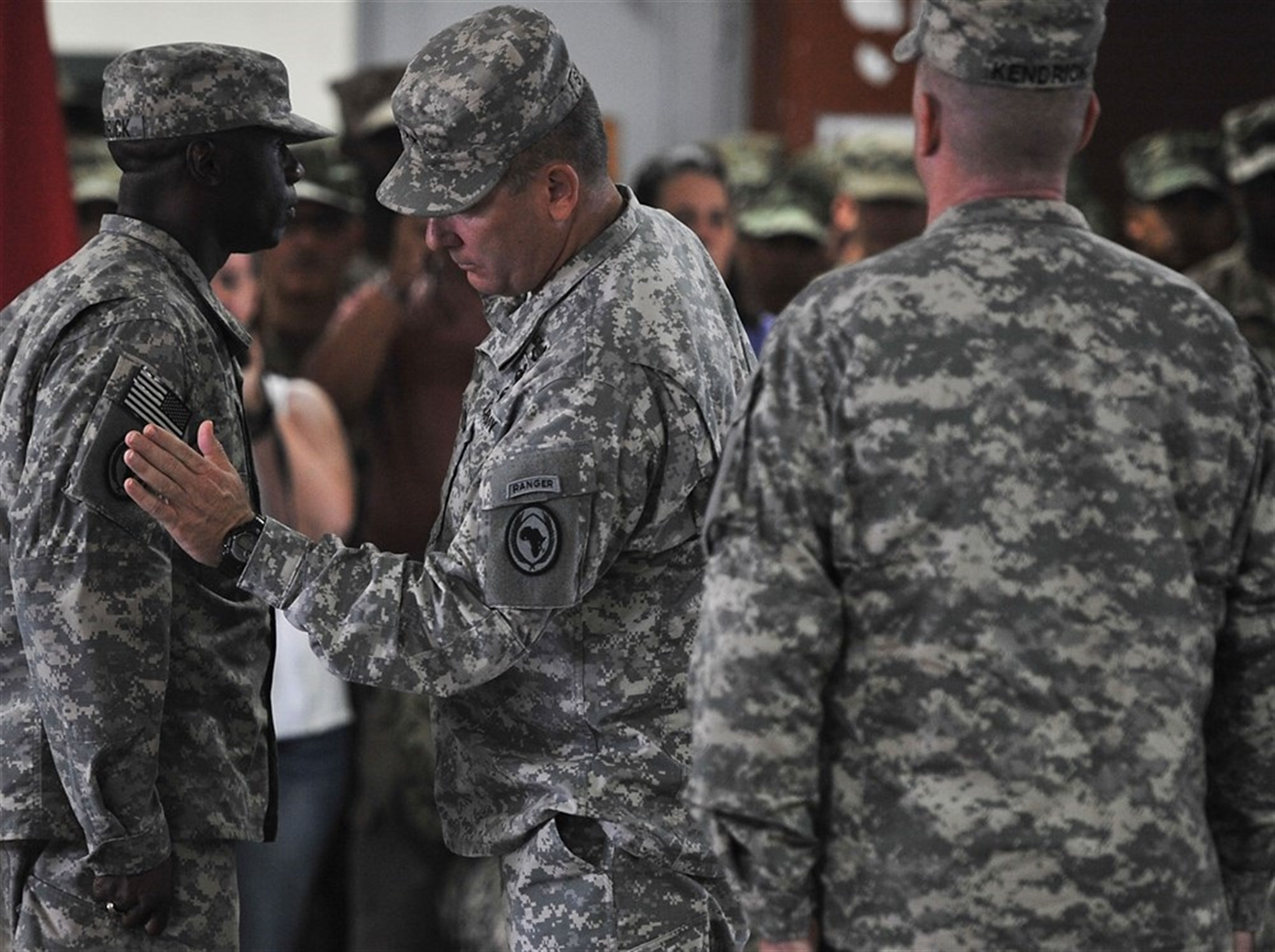 U.S. Maj. Gen. Mark Stammer, Combined Joint Task Force-Horn of Africa commanding general, presents Command Sgt. Maj. Butler Kendrick Jr. with the U.S. Africa Command combat patch during a ceremony at Camp Lemonnier, Djibouti, Nov. 28, 2015. The soldiers assigned to CJTF-HOA are now authorized to wear the U.S. Africa Command patch for the duration of their careers. (U.S. Air Force photo by Tech. Sgt. Dan DeCook)