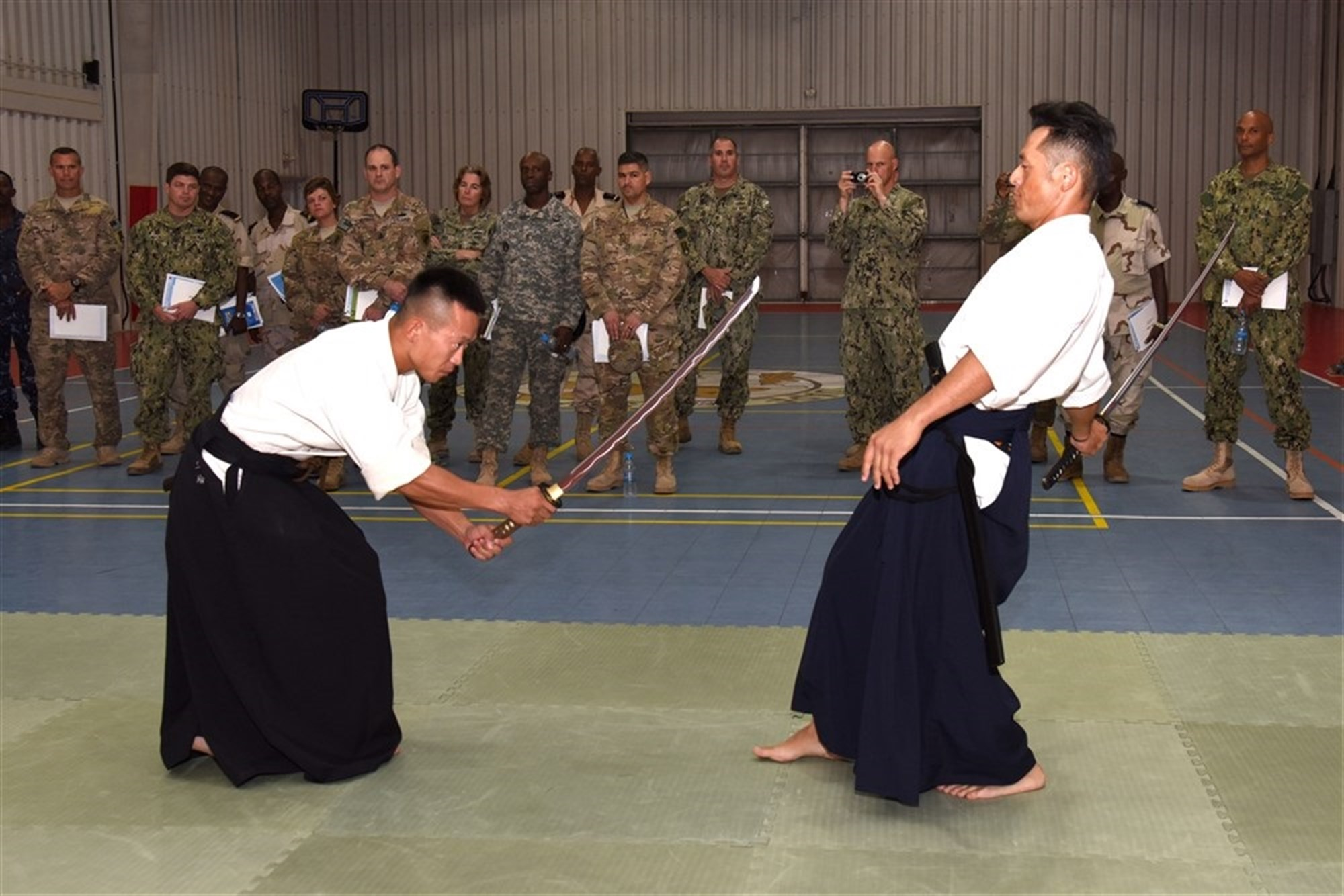 Participants from the Joint Forces Senior Enlisted Professional Development Course view a traditional swordsmanship demonstration at the Japanese base in Djibouti, Nov. 24, 2015. The Japan Self-Defense Forces hosted the second gathering of senior enlisted members to share their culture and mission. (U.S. Air Force photo by Staff Sgt. Victoria Sneed)