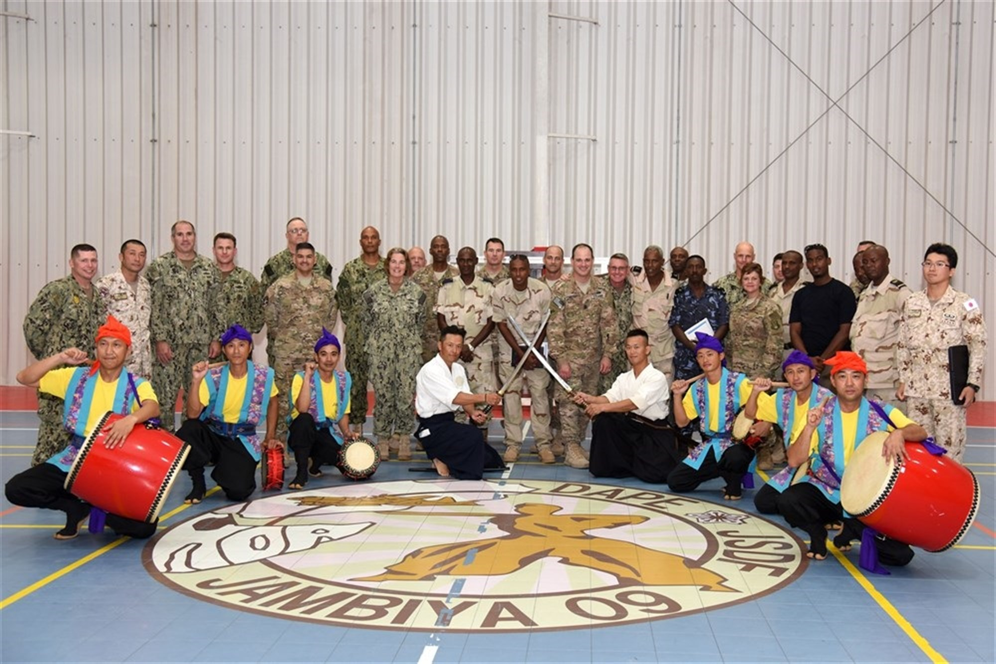Senior enlisted members from Japan, Djibouti and the U.S. join in a traditional Eisa dance during the Joint Forces Senior Enlisted Professional Development Course at the Japanese base in Djibouti, Nov. 24, 2015. Eisa is a traditional dance, unique to Okinawa, the southernmost prefecture of Japan, and is performed during seasonal festivals to honor and thank ancestors. (U.S. Air Force photo by Staff Sgt. Victoria Sneed)