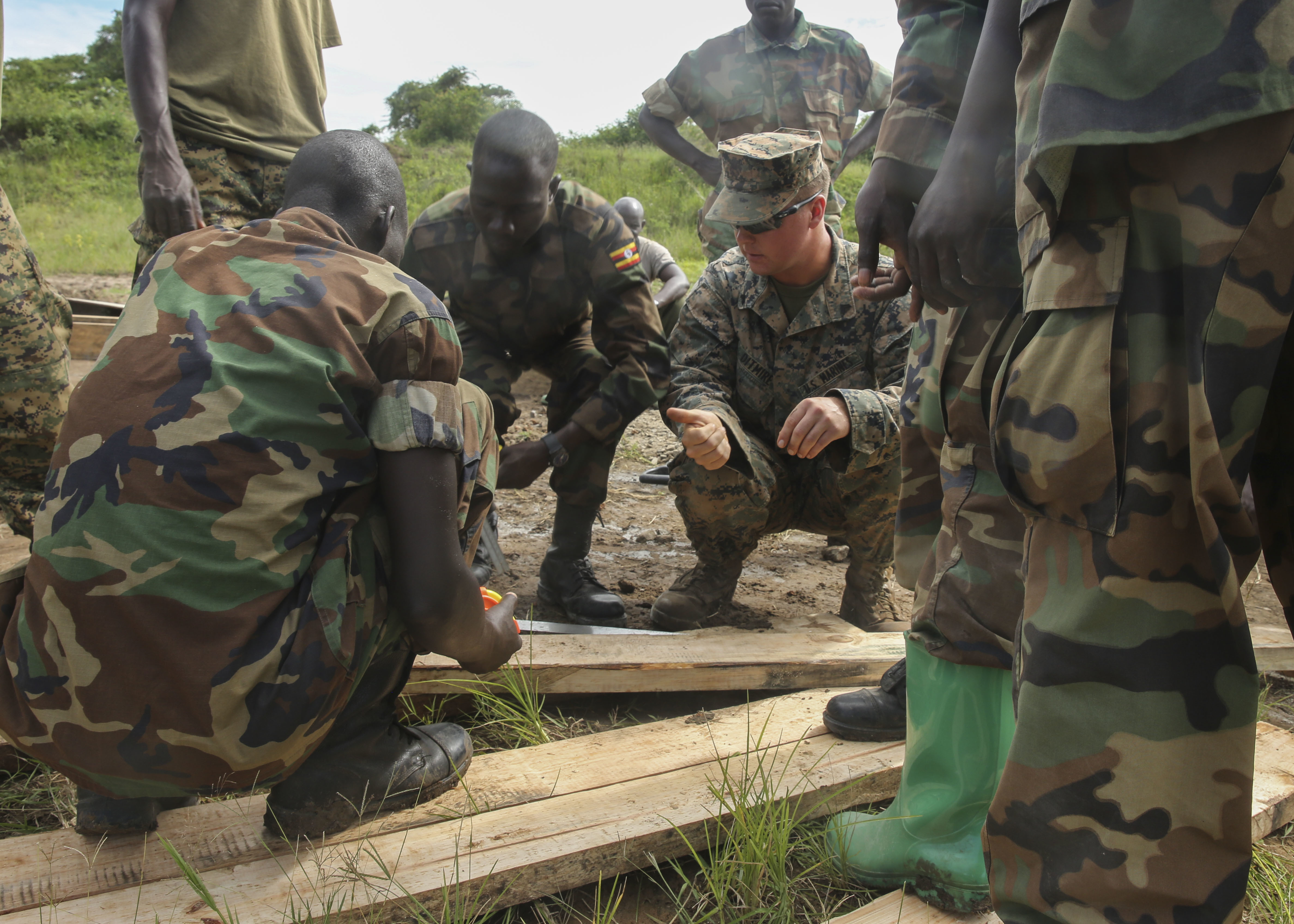 U.S. Marine Cpl. Brandon Ditmire, a combat engineer with Special-Purpose Marine Air-Ground Task Force Crisis Response-Africa, gives a thumbs-up to a Uganda People's Defense Force soldier during a civil engineering exercise at Camp Singo, Nov. 16, 2015. The exercise helps the partner nations fortify their civil engineering skills while strengthening the bond between the two. (U.S. Marine Corps photo by Cpl. Olivia McDonald/Released)