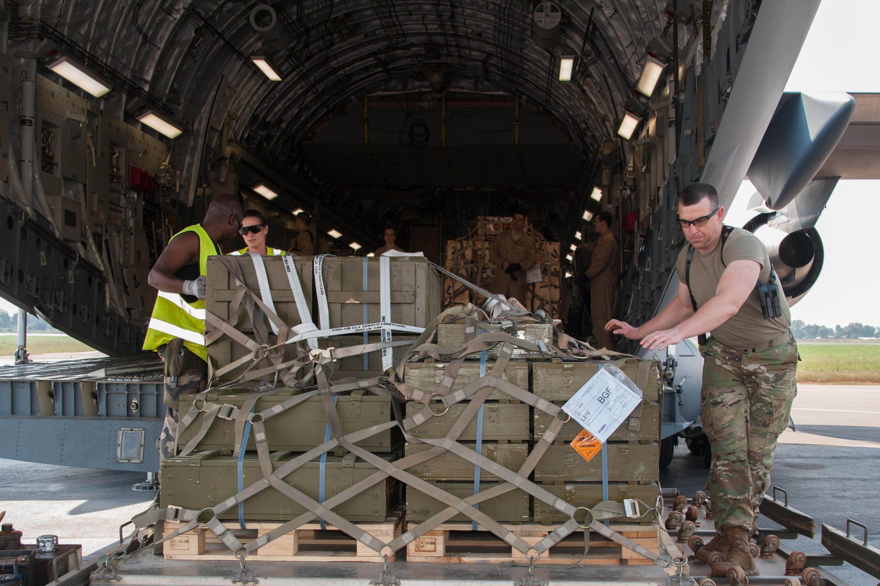 Strategic Lift - U.S. Air Force Crew Loads Aravis:  McGuire Air Force Base and McChord Air Force Base personnel work together to load a Gabonese armored personnel carrier on a C-17 before departing for Bangui, Central African Republic; Dec. 15, 2015, Libreville, Gabon. Both the U.S. and France provided military manpower in Libreville, Gabon, and the Central African Republic's capital, Bangui, to help with the loading/unloading and transport of equipment.  The result was the timely deployment of more than 450,000 pounds of vital equipment and vehicles for the Gabonese military. (Photo courtesy of French military, ADC Laminette/RELEASED)