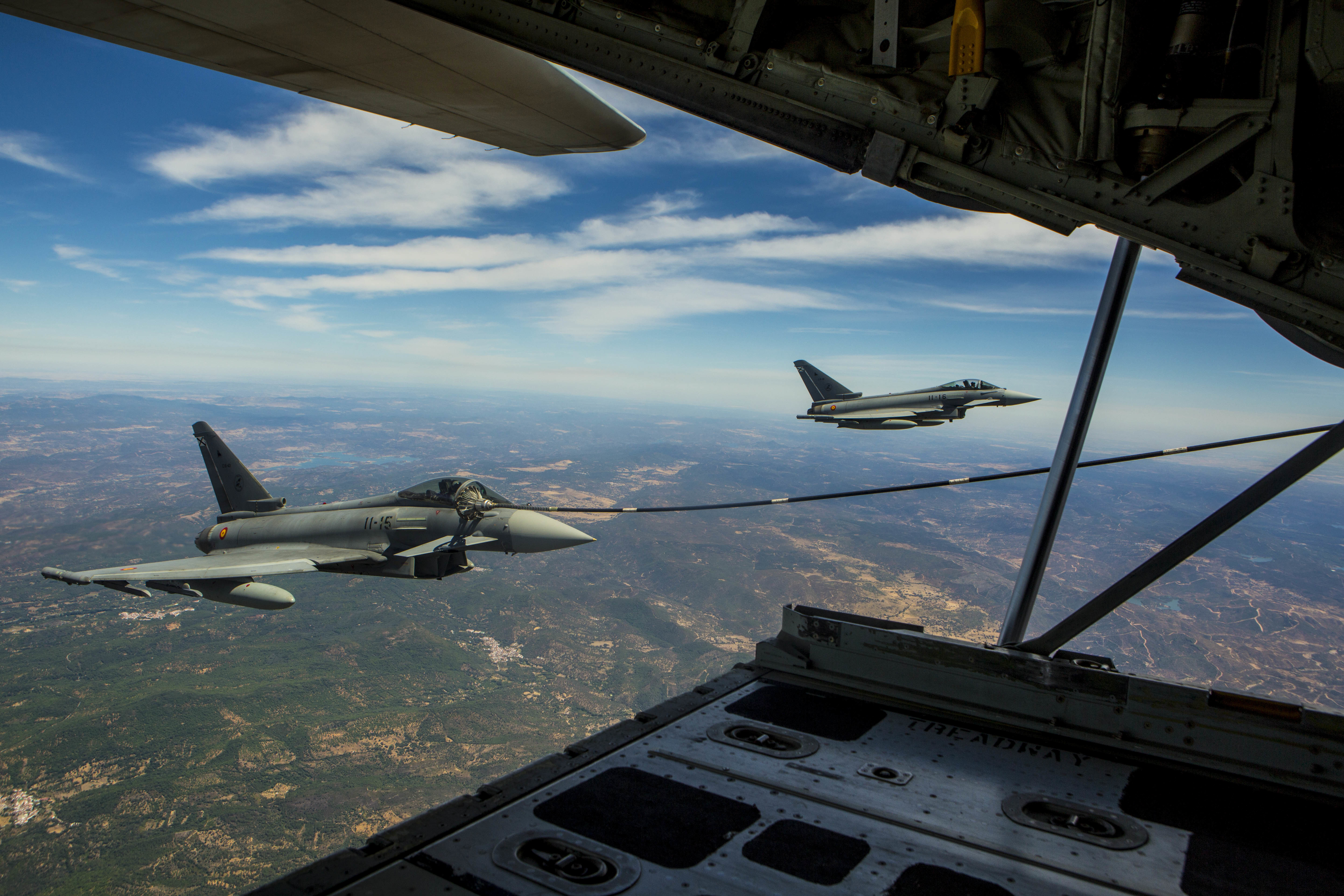 A Eurofighter Typhoon with the Spanish Air Force receives fuel from a U.S. Marine KC-130J Hercules with Special-Purpose Marine Air-Ground Task Force Crisis Response-Africa, August 13, in Spain. A total of five Spanish pilots and their aircraft had the opportunity to practice their air-to-air refueling skills with the Marines from SPMAGTF-CR-AF. While this particular training was a first for the two countries, the U.S. and Spain work together routinely, fostering one of the closest defense partnerships around the world.(U.S. Marine Corps photo by Staff Sgt. Vitaliy Rusavskiy/Released)