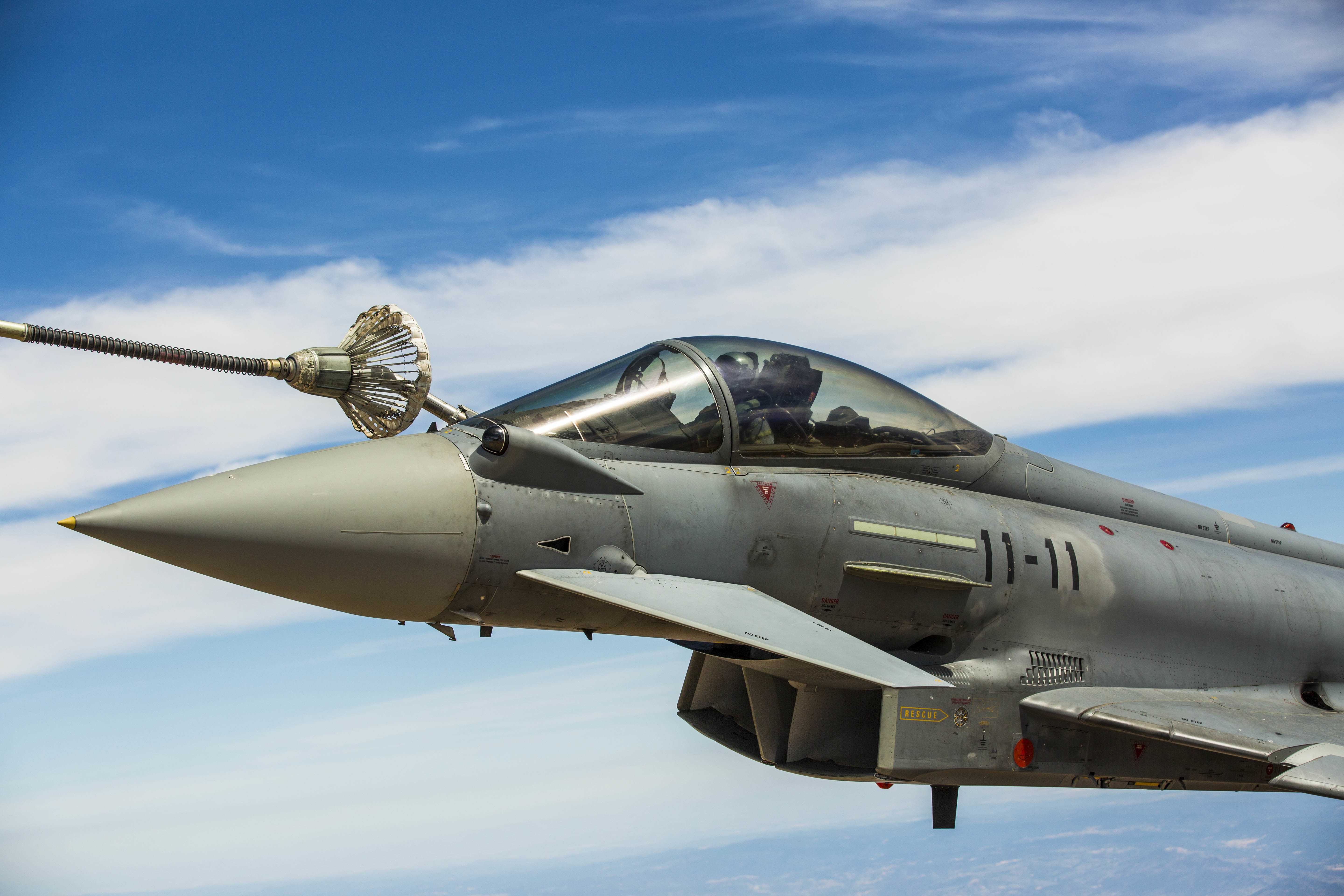 A Eurofighter Typhoon with the Spanish Air Force based out of Morón Air Base, Spain, refuels from a KC-130J Hercules, a first for the Marines from Special-Purpose Marine Air-Ground Task Force Crisis Response-Africa, Aug. 13, in Spain. The U.S. and Spain have been fostering one of the closest defense partnerships around the world for more than 60 years. (U.S. Marine Corps photo by Staff Sgt. Vitaliy Rusavskiy/Released)
