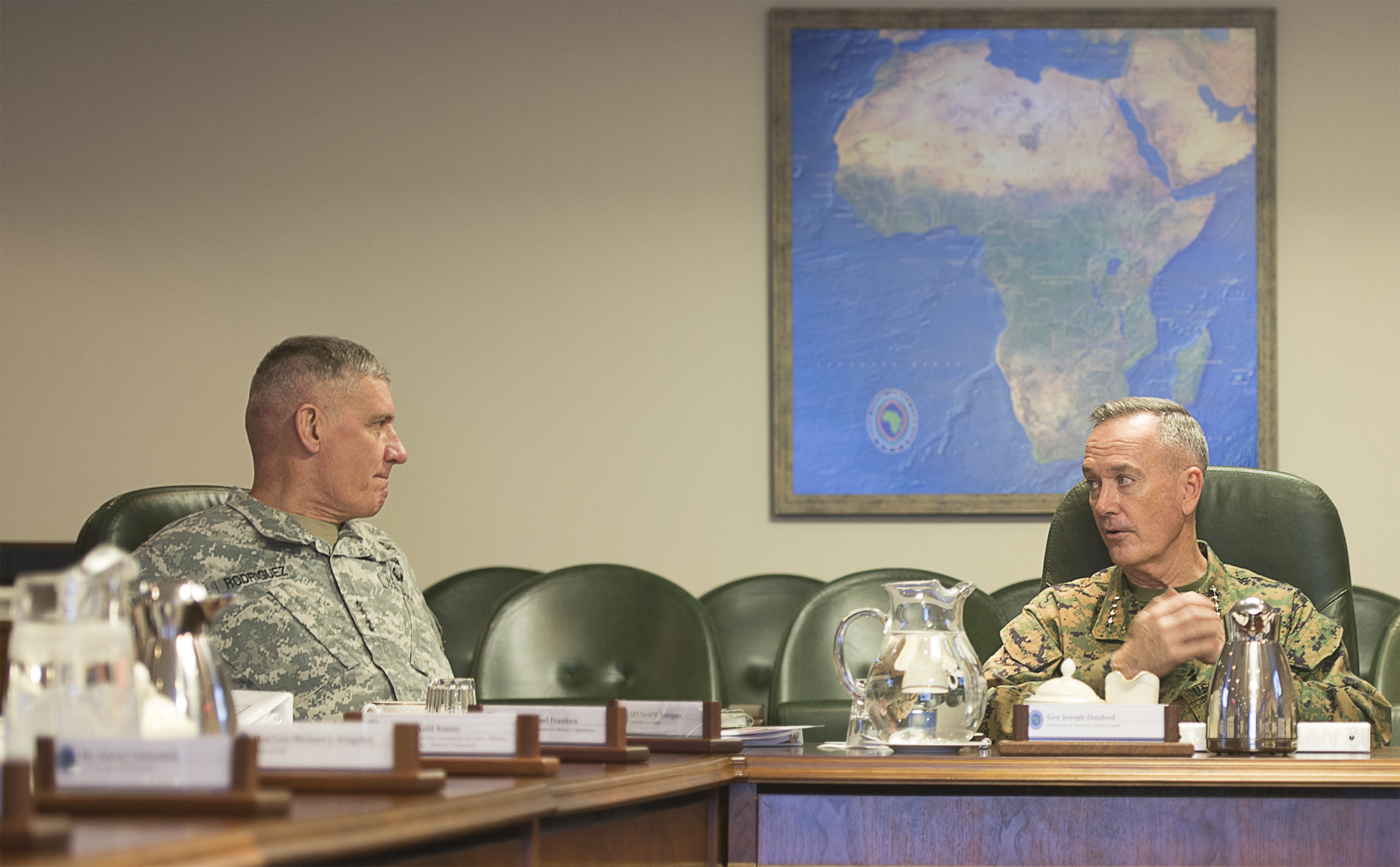 U.S. Marine Gen. Joseph F. Dunford Jr., chairman of the Joint Chiefs of Staff, (right) meets with U.S. Army Gen. David M. Rodriguez, commander, U.S. Africa Command, at AFRICOM headquarters in Stuttgart, Germany Jan. 4, 2016. (DoD Photo by Navy Petty Officer 2nd Class Dominique A. Pineiro)
