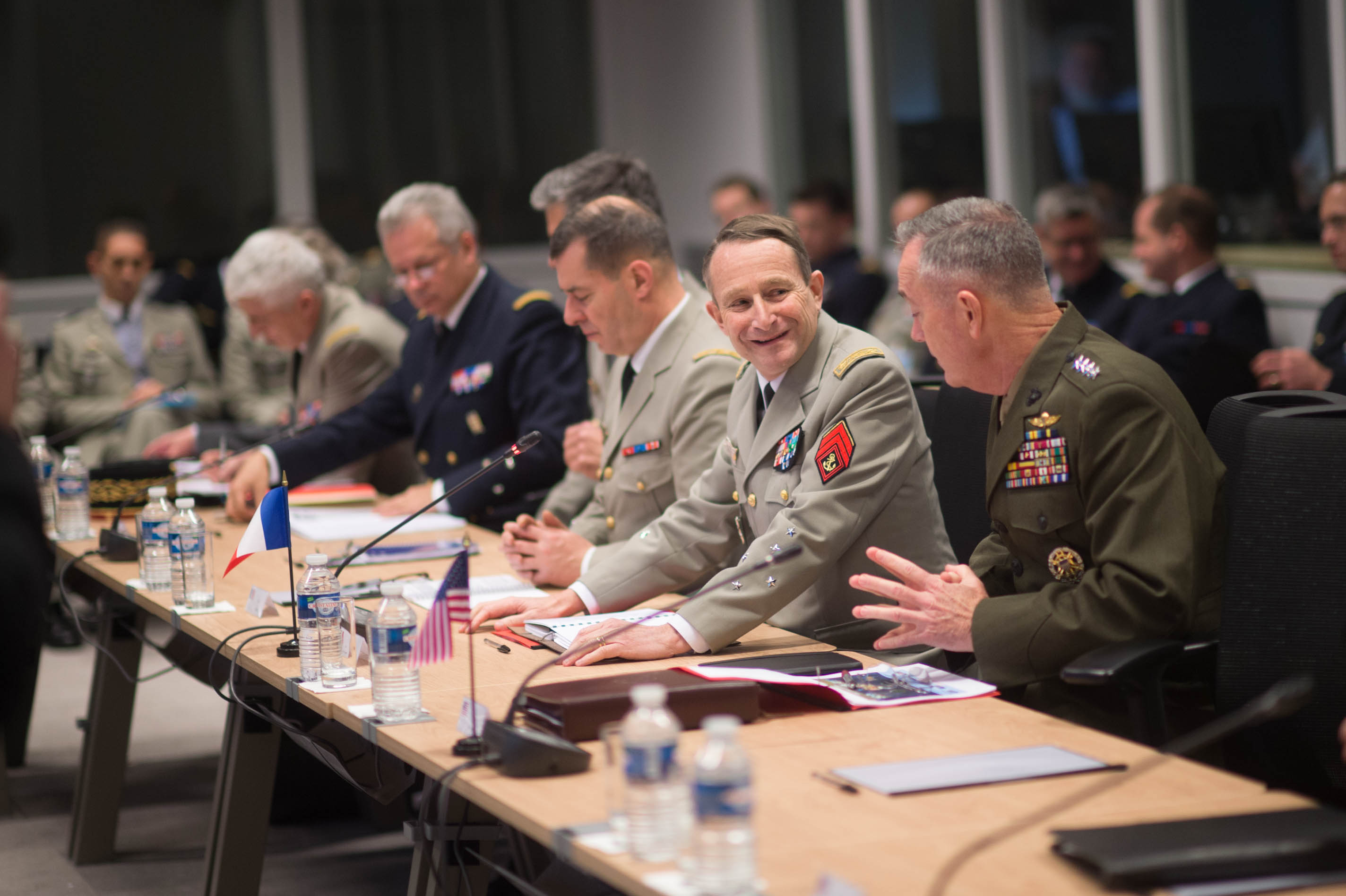 U.S. Marine Corps Gen. Joseph F. Dunford Jr., right, chairman of the Joint Chiefs of Staff, and Gen. Pierre de Villiers, chief of France's defense staff, talk during a meeting at the French defense headquarters in Paris, Jan. 22, 2016