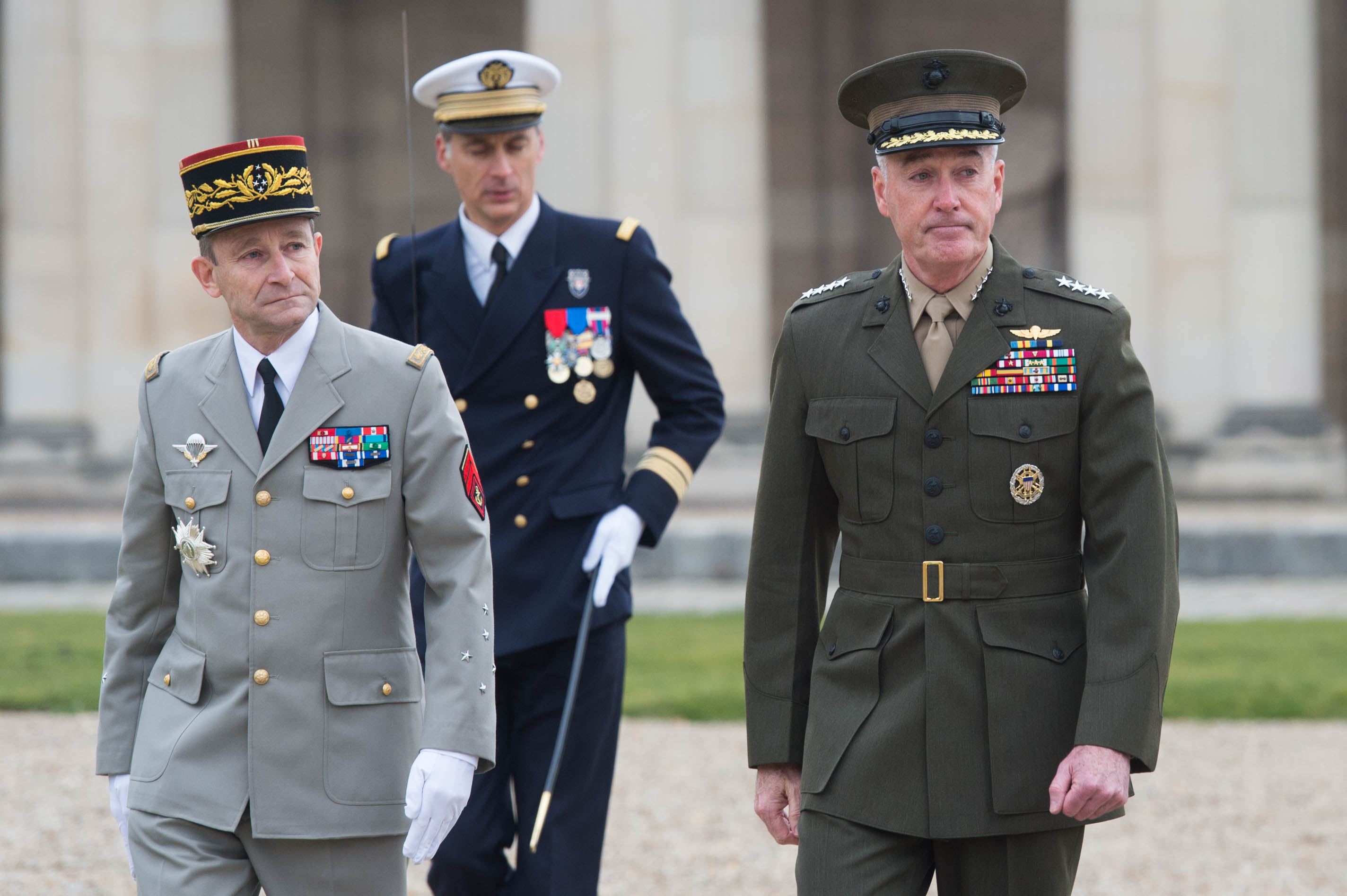 U.S. Marine Corps Gen. Joseph F. Dunford Jr., right, chairman of the Joint Chiefs of Staff, and Gen. Pierre de Villiers, chief of France's defense staff, conduct a military honors ceremony at Ecole Militarie, a military school, in Paris, Jan. 22, 2016.