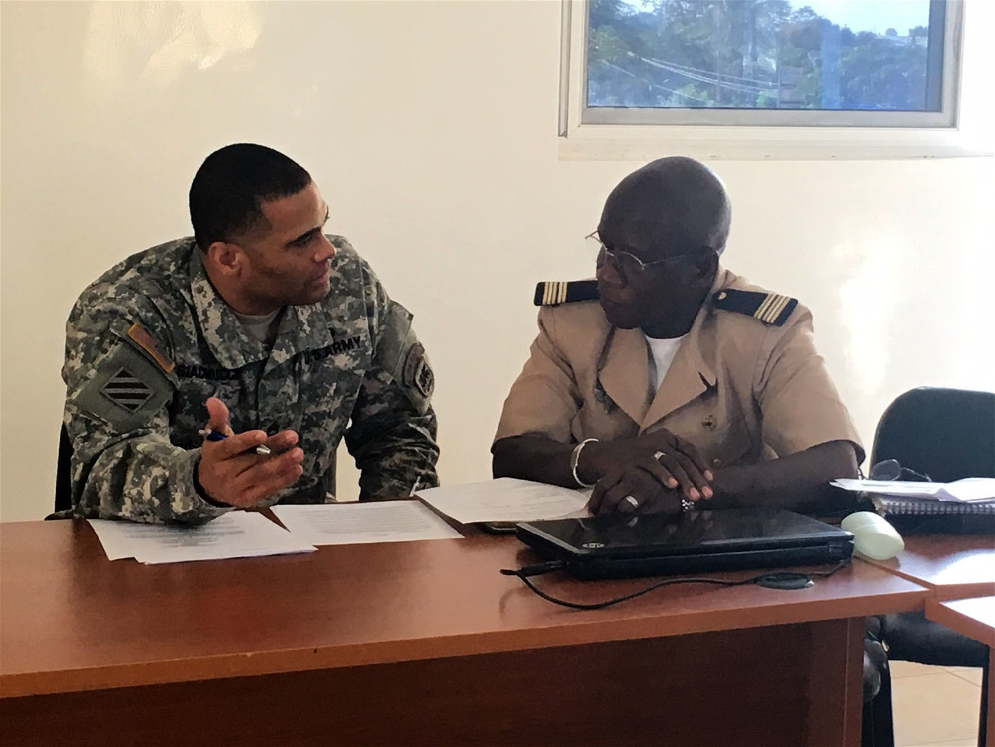 Sgt. First Class Jason Giacomucci, logistics planner for U.S. Army Africa, and Lt. Col. Mamadou Laminet Kouate, logistics officer for the Senegalese Army, discuss plans to support the African Readiness Training 2016 exercise during the initial planning event in Dakar, Senegal, Jan. 12-14. (U.S. Army Africa photo by Capt. Anielka DiFelice)
