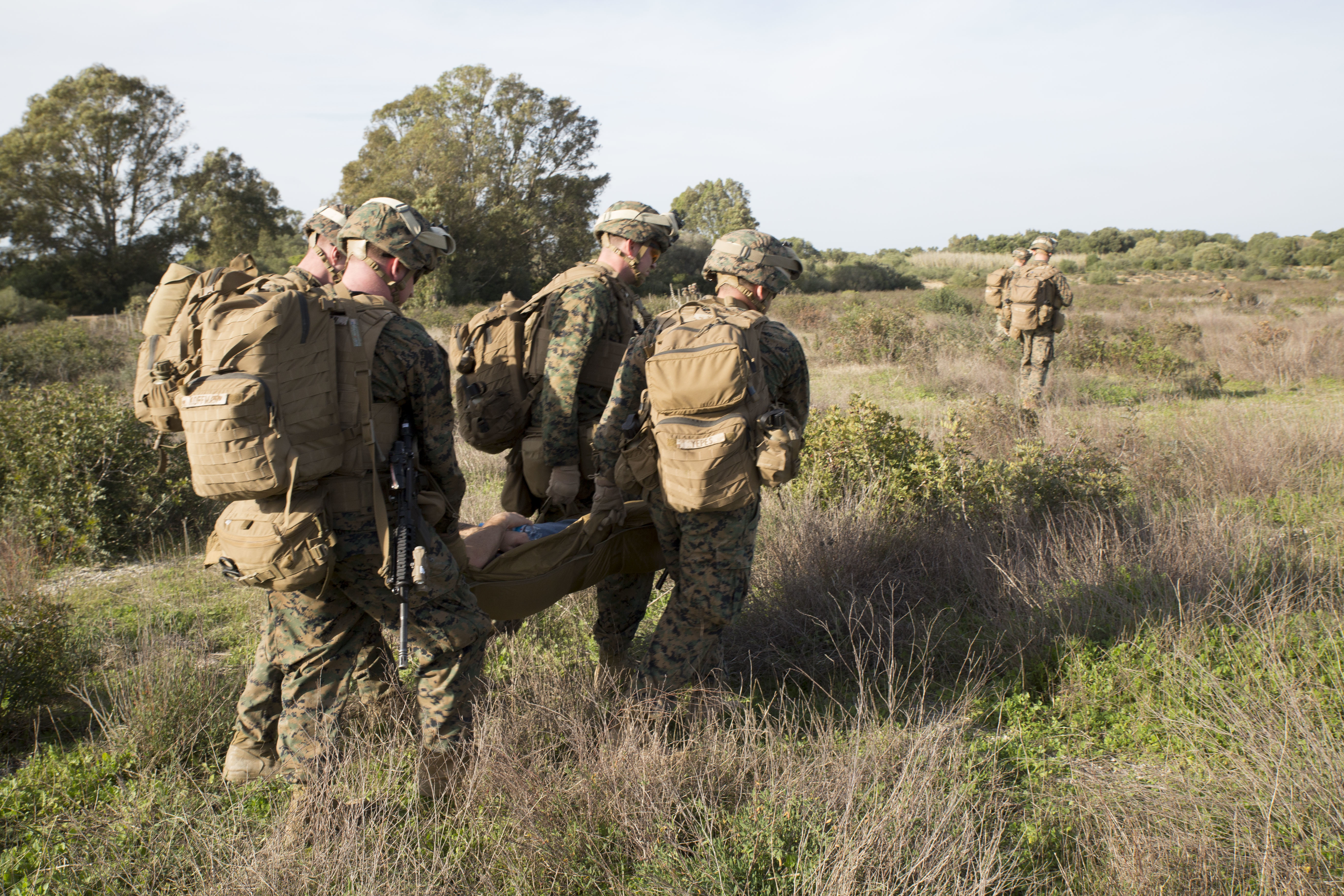 U.S. Marines with Special-Purpose Marine Air-Ground Task Force Crisis Response-Africa extract a simulated casualty during quick-response training aboard Naval Station Rota, Spain, January 23, 2016. The alert force tested the unit's capabilities by simulating the procedures of reacting to a time-constrained, crisis-response mission. (U.S. Marine Corps photo by Sgt. Tia Nagle)