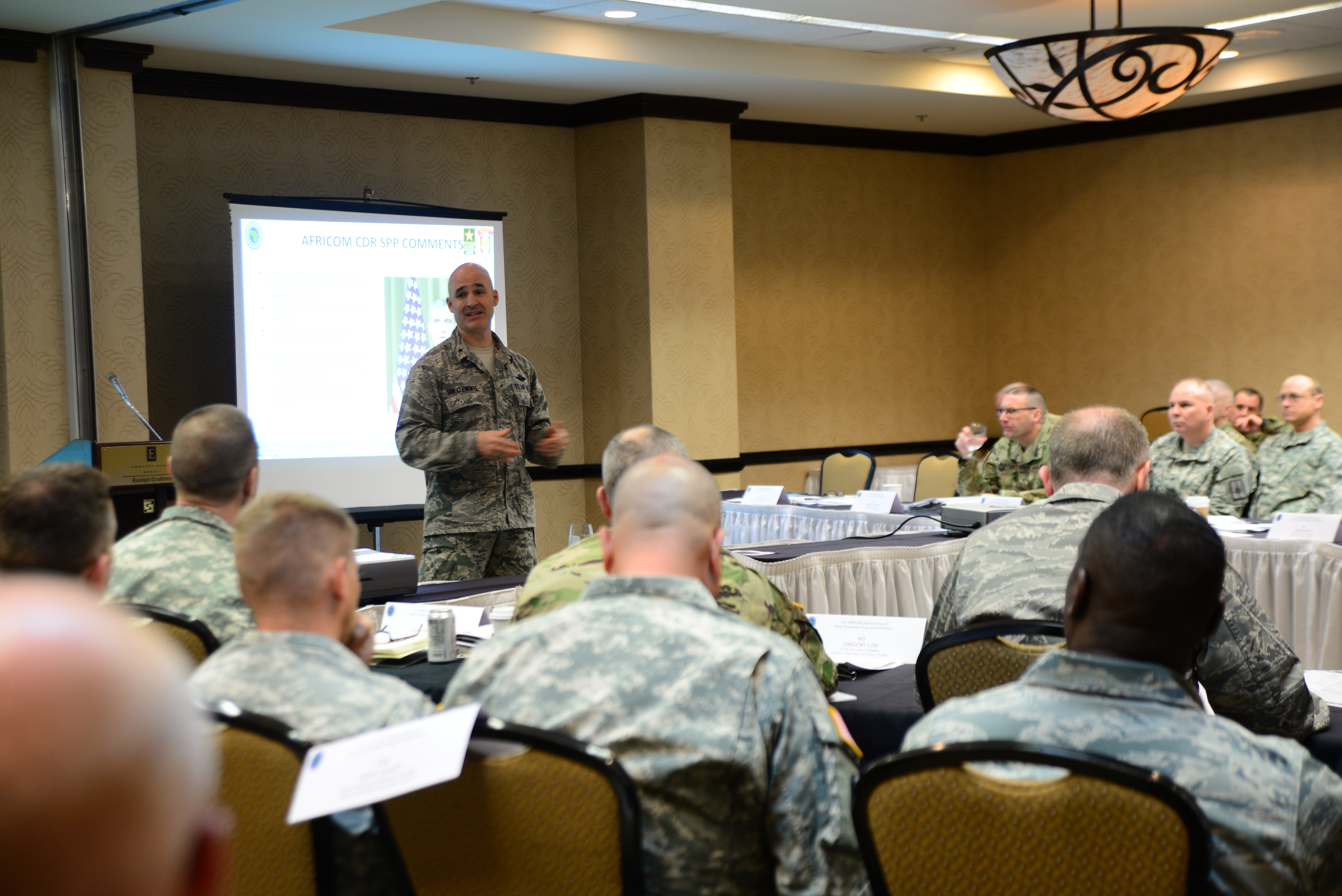Air Force Brig. Gen. David San Clemente, deputy director for strategy, plans and program at AFRICOM, speaks to senior leaders of ten National Guard states from across the U.S., U.S. Africa Command and U.S. Army Africa, about strategic and long-term planning at the State Partnership Program conference in Raleigh, N.C., Jan. 26, 2016.  The service members met at the conference to discuss the long-term strategic plans and programs for AFRICOM. These plans include security force assistance programs, strengthening institutions and regional approaches to disaster preparedness. (U.S. Army National Guard photo by Sgt. Lisa Vines, Public Affairs Office/Released)
