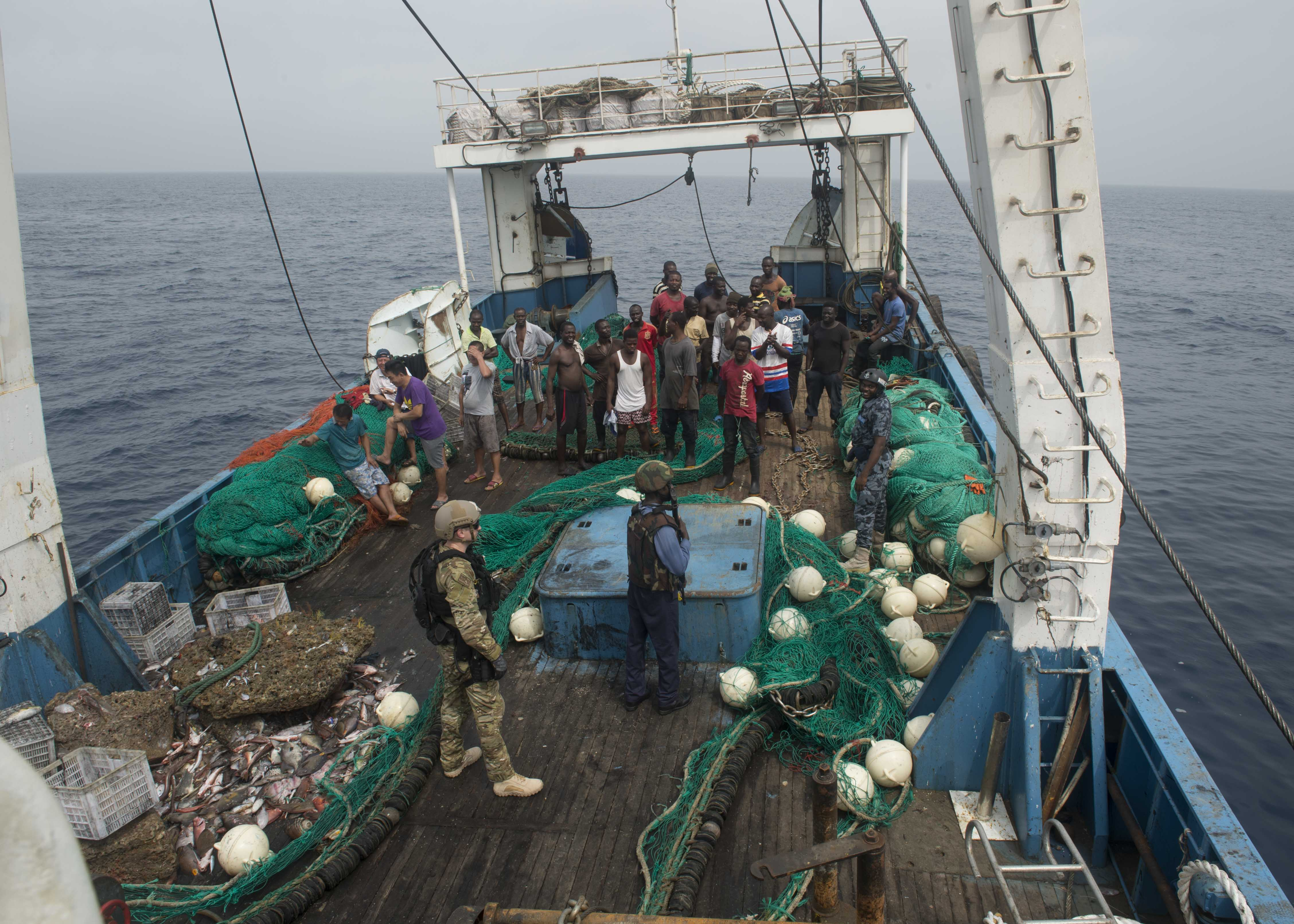 ATLANTIC OCEAN (Feb. 04, 2016) – Members of the Ghanaian Navy and U.S. Coast Guard Tactical Law Enforcement Detachment board a fishing vessel during combined joint boarding operations Feb. 04, 2016. The Military Sealift Command expeditionary fast transport vessel USNS Spearhead (T-EPF 1) is on a scheduled deployment in the U.S. 6th Fleet area of operations to support the international collaborative capacity-building program Africa Partnership Station. (U.S. Navy photo by Mass Communication Specialist 3rd Class Amy M. Ressler/Released)