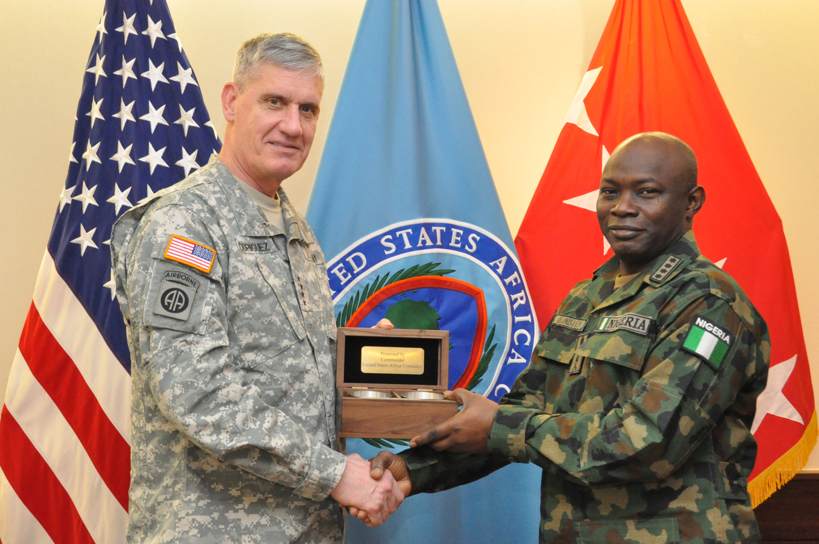 Gift exchange: Gen. David Rodriguez, commander, U.S. Africa Command (left), presents a gift of appreciation to Gen. Abayomi Olonisakin, Nigeria chief of defence staff. AFRICOM hosted a two-day meeting that brought together AFRICOM component commanders and several senior members of the Nigerian military.  The purpose of the visit was to reinforce the importance of a strong US-Nigeria security cooperation relationship, with topics focused on ways to counter terrorism, joint operations, logistics and maritime security in the Gulf of Guinea, Feb. 10, 2016, U.S. Army Garrison Stuttgart, Germany. (Photo by Brenda Law, U.S. Africa Command Public Affairs/RELEASED)
