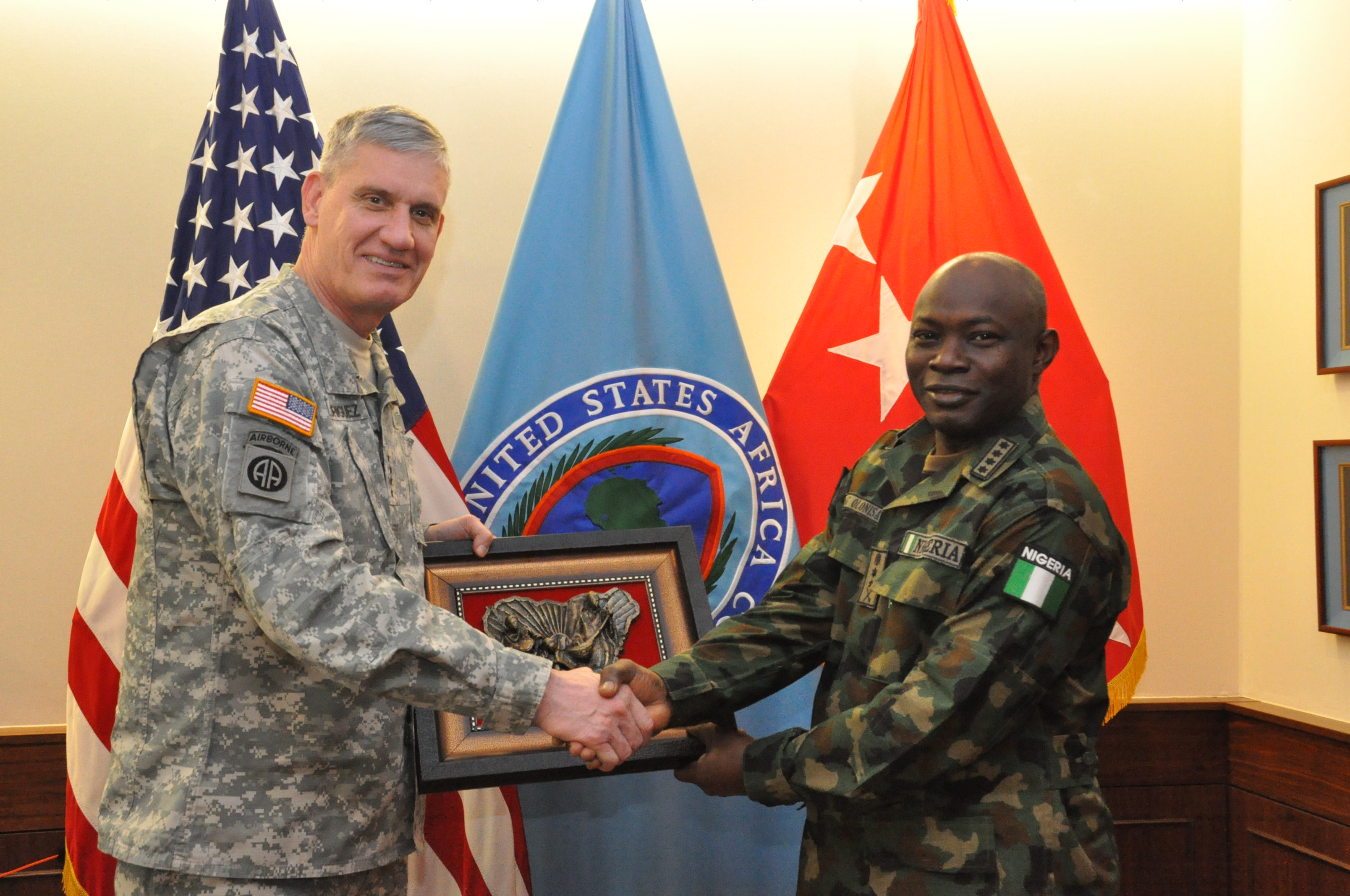Gift exchange: Gen. Abayomi Olonisakin, Nigeria chief of defence staff (right) presents a gift of appreciation to Gen. David Rodriguez, commander, U.S. Africa Command.  AFRICOM hosted a two-day meeting that brought together AFRICOM component commanders and several senior members of the Nigerian military.  The purpose of the visit was to reinforce the importance of a strong US-Nigeria security cooperation relationship, with topics focused on ways to counter terrorism, joint operations, logistics and maritime security in the Gulf of Guinea, Feb. 10, 2016, U.S. Army Garrison Stuttgart, Germany. (Photo by Brenda Law, U.S. Africa Command Public Affairs/RELEASED)