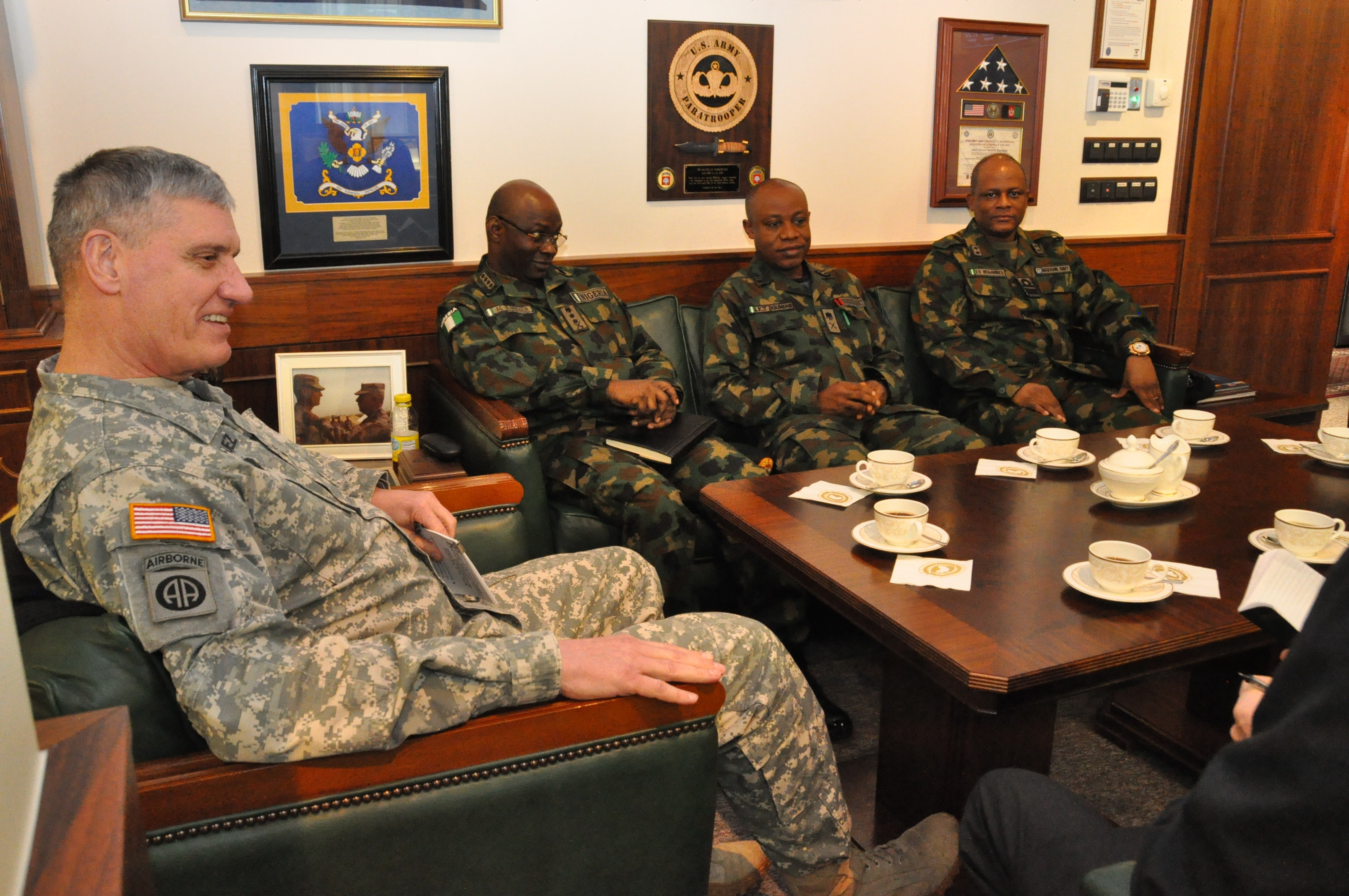 Gen. David Rodriguez, commander, U.S. Africa Command (left) meets with Gen. Abayomi Olonisakin Nigeria chief of defence staff (second from left) and several of his senior military leaders during an office call.  AFRICOM hosted a two-day meeting that brought together the component commanders and several senior members of the Nigerian military.  The purpose of the visit was to reinforce the importance of a strong US-Nigeria security cooperation relationship, with topics focused on ways to counter terrorism, joint operations, logistics and maritime security in the Gulf of Guinea, Feb. 10, 2016, U.S. Army Garrison Stuttgart, Germany. (Photo by Brenda Law, U.S. Africa Command Public Affairs/RELEASED)