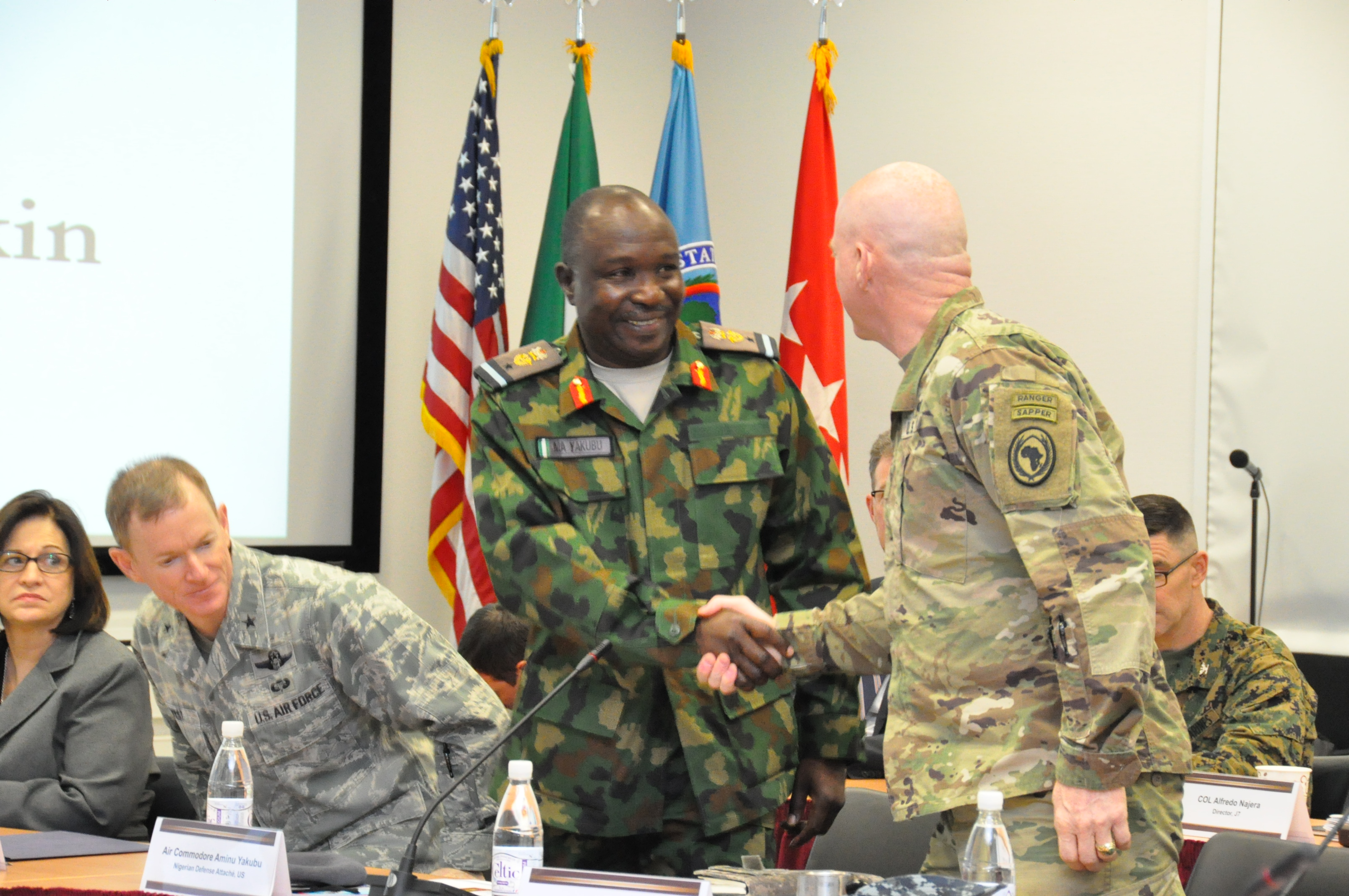 Air Commodore Aminu Yakubu, Nigeria defence attaché is greeted by Maj. Gen. Bryan Watson, AFRICOM director of operations.  The two were participants in a two-day meeting with Gen. Abayomi Olonisakin, Nigeria CDS, and several of his most senior officers and AFRICOM staff and component commanders.  The purpose of the visit was to reinforce the importance of a strong US-Nigeria security cooperation relationship with topics focused on ways to counter terrorism, joint operations, logistics and maritime security in the Gulf of Guinea, Feb. 9, 2016, U.S. Army Garrison Stuttgart, Germany. (Photo by Brenda Law, U.S. Africa Command Public Affairs/RELEASED)