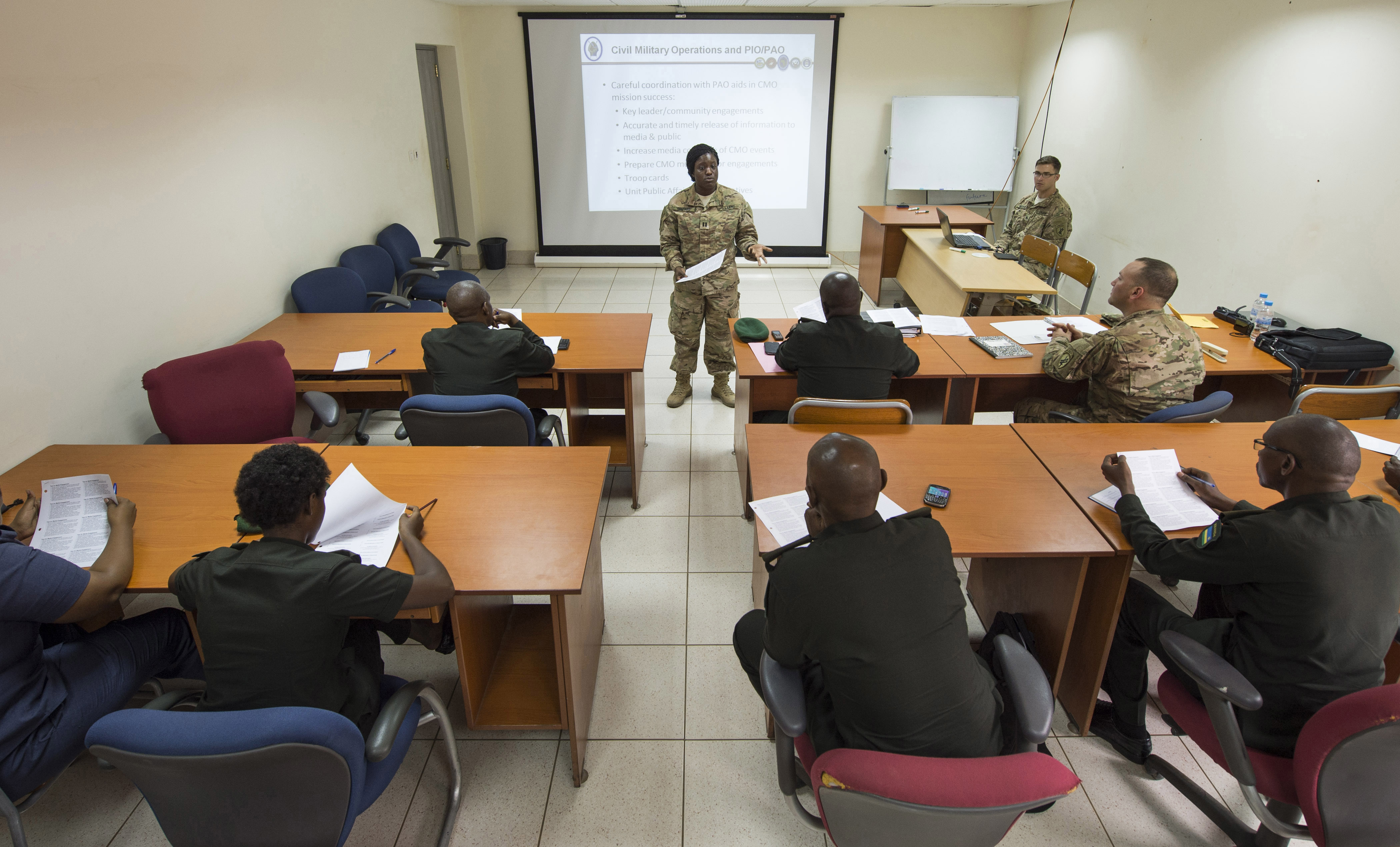 U.S. Army Capt. Morgan Shepard, Combined Joint Task Force-Horn of Africa Public Information officer, discusses civil military operations and the roles of Public Affairs and Public Information Officers, Feb. 2, 2016, at RDF headquarters, Kigali, Rwanda. During the engagement, U.S. Army civil affairs and Rwanda Defense Force Civil Military Co-operation (CIMIC) discussed similarities and differences between the organizations. The RDF will use the knowledge gained during the event to address training and organizational needs for their forces. (U.S. Air Force photo by Senior Airman Peter Thompson)