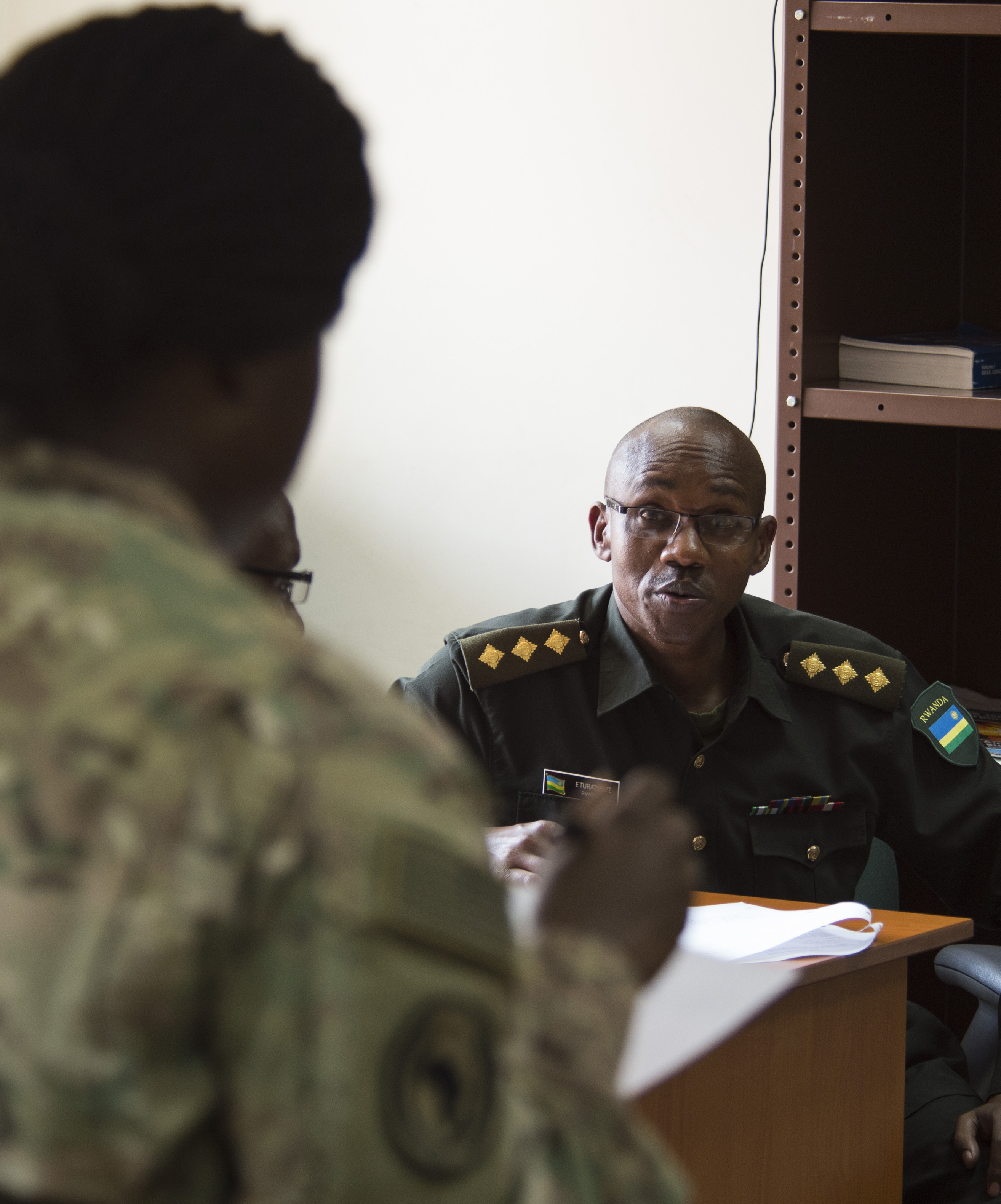 U.S. Army Capt. Morgan Shepard, Combined Joint Task Force-Horn of Africa Public Information officer, listens as Rwanda Defense Force Army Capt. Edouard Turatsinze, Ministry of Defense Public Relations and Communications officer, discusses a topic Feb. 2, 2016, at RDF headquarters, Kigali, Rwanda. CIMIC officers have many of the same roles and responsibilities as U.S. Army civil affairs personnel. Army civil affairs specialists are responsible for researching, coordinating, conducting and participating in the planning and production of civil affairs related documents, while enabling the civil-military operations of the supported commander. (U.S. Air Force photo by Senior Airman Peter Thompson)