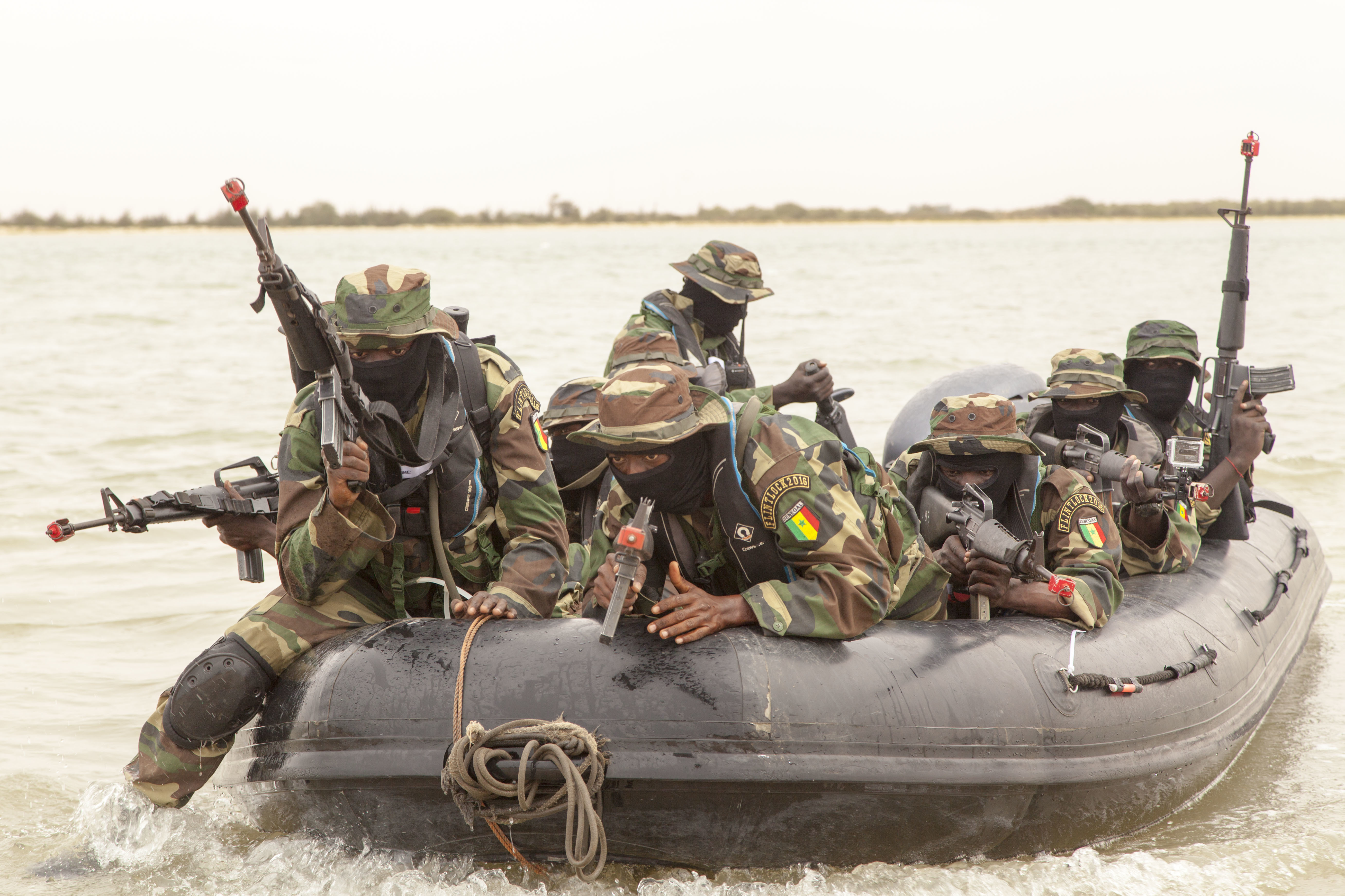 Senegalese Special Operations Forces conduct a beach landing exercise during Flintlock 2016 in Saint Louis, Senegal, Feb. 12, 2016. Riverine type operations are important in Military Zone 2 in Saint Louis because the region has 700 kilometers of coastline. The riverine operation was a culmination exercise after a weeklong training with Netherlands and U.S. Special Operation Forces. Flintlock 2016 is designed to enhance interoperatibility among all participating nations. (U.S. Army Photo by Spc. David M. Shefchuk)