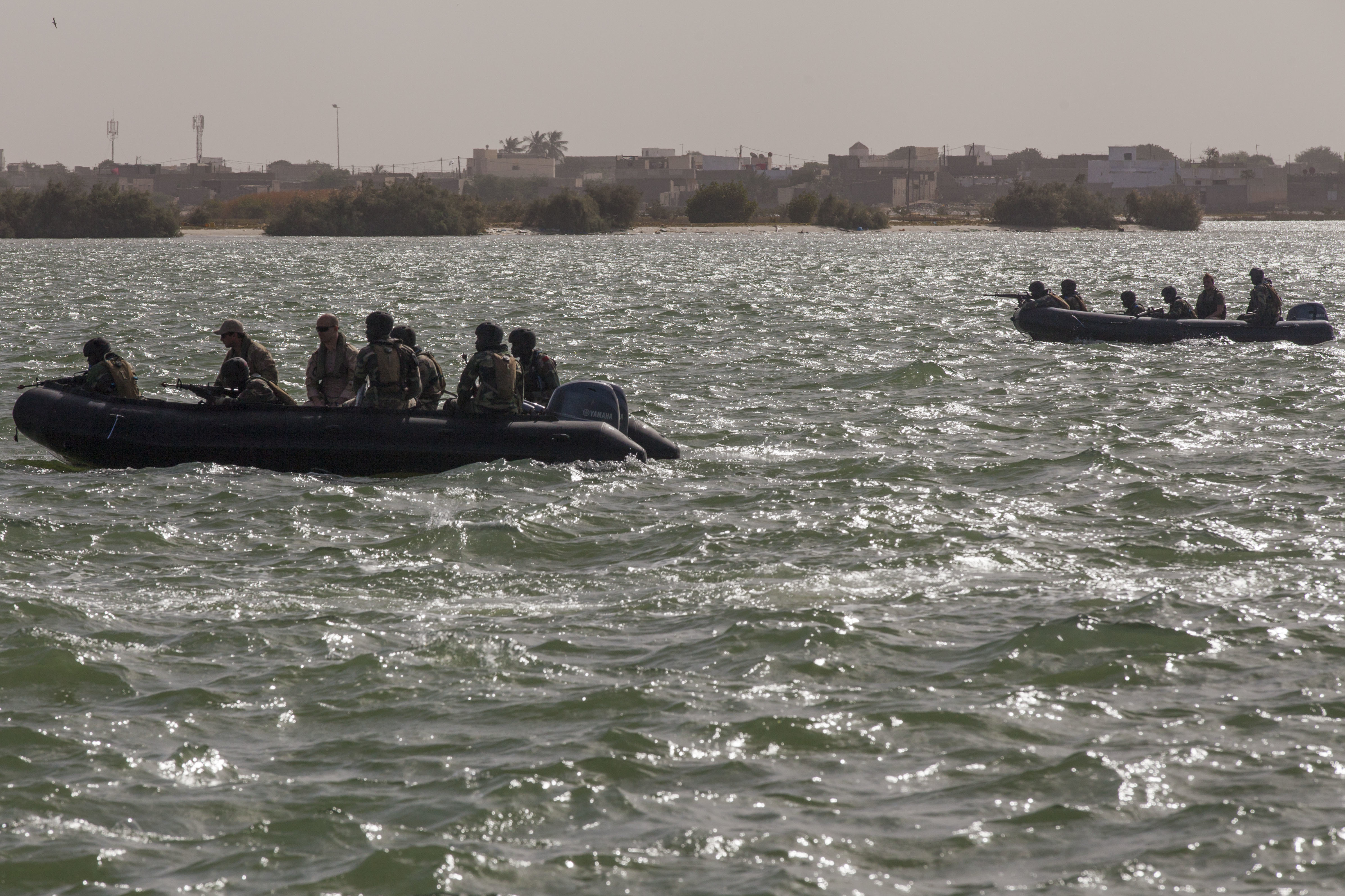 Senegalese Navy Special Operations Forces ride in Zodiac boats during beach landing training in Saint Louis, Senegal, Feb. 11, 2016. The Senegalese Navy Special Operations Forces were training with the Netherlands and U.S. Special Operations Forces as a part of Flintlock 2016. Flintlock is an African-led military exercise focused on security, counter-terrorism and military humanitarian support to outlying areas. (U.S. Army Photo by Spc. David M. Shefchuk/Released)