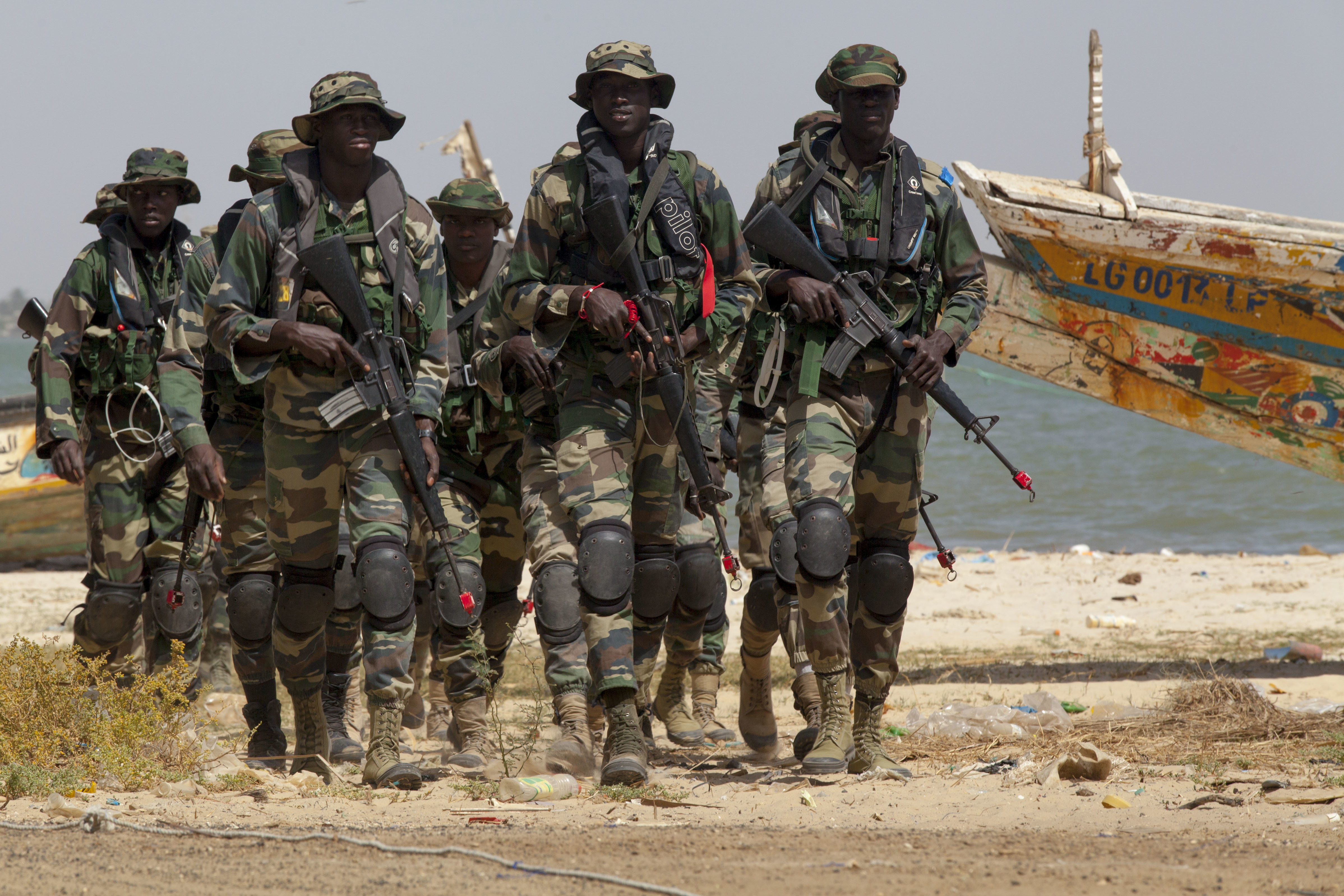 Senegalese Navy Special Operations Forces prepare for a beach landing exercise in Saint Louis, Senegal, Feb. 11, 2016. The beach landings were a part of the multinational exercise Flintlock 2016. More than 1,700 Special Operation Forces personnel from Africa, Europe and North America participated in Flintlock 2016. (U.S. Army Photo by Spc. David M. Shefchuk/Released)
