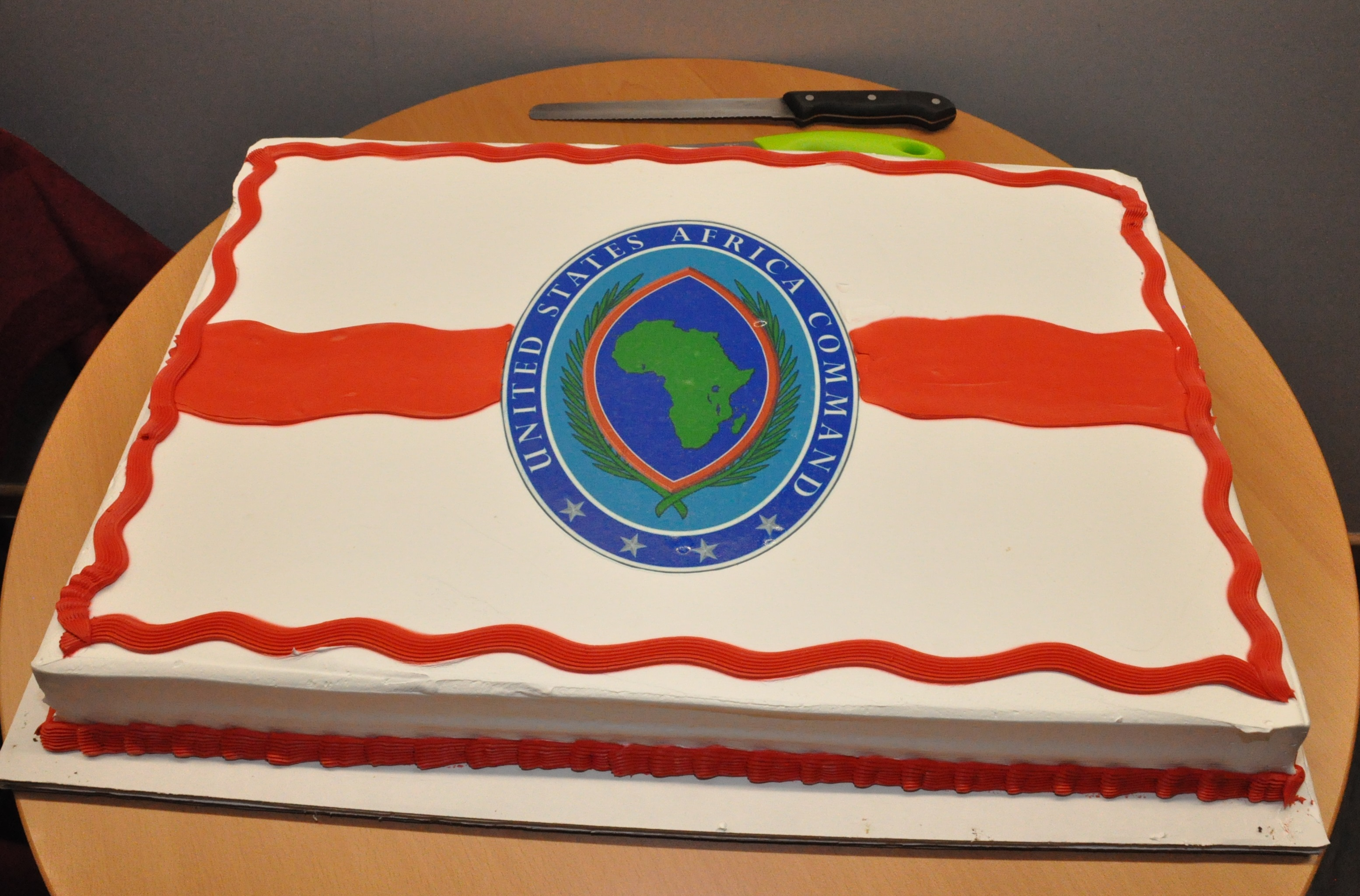 Yummy - and yes, we have cake! – A cake with the AFRICOM logo was served during an open house event for the new joint operations center, Feb. 5, 2016, U.S. Army Garrison Stuttgart, Germany. (U.S. Africa Command photo by Brenda Law/RELEASED)