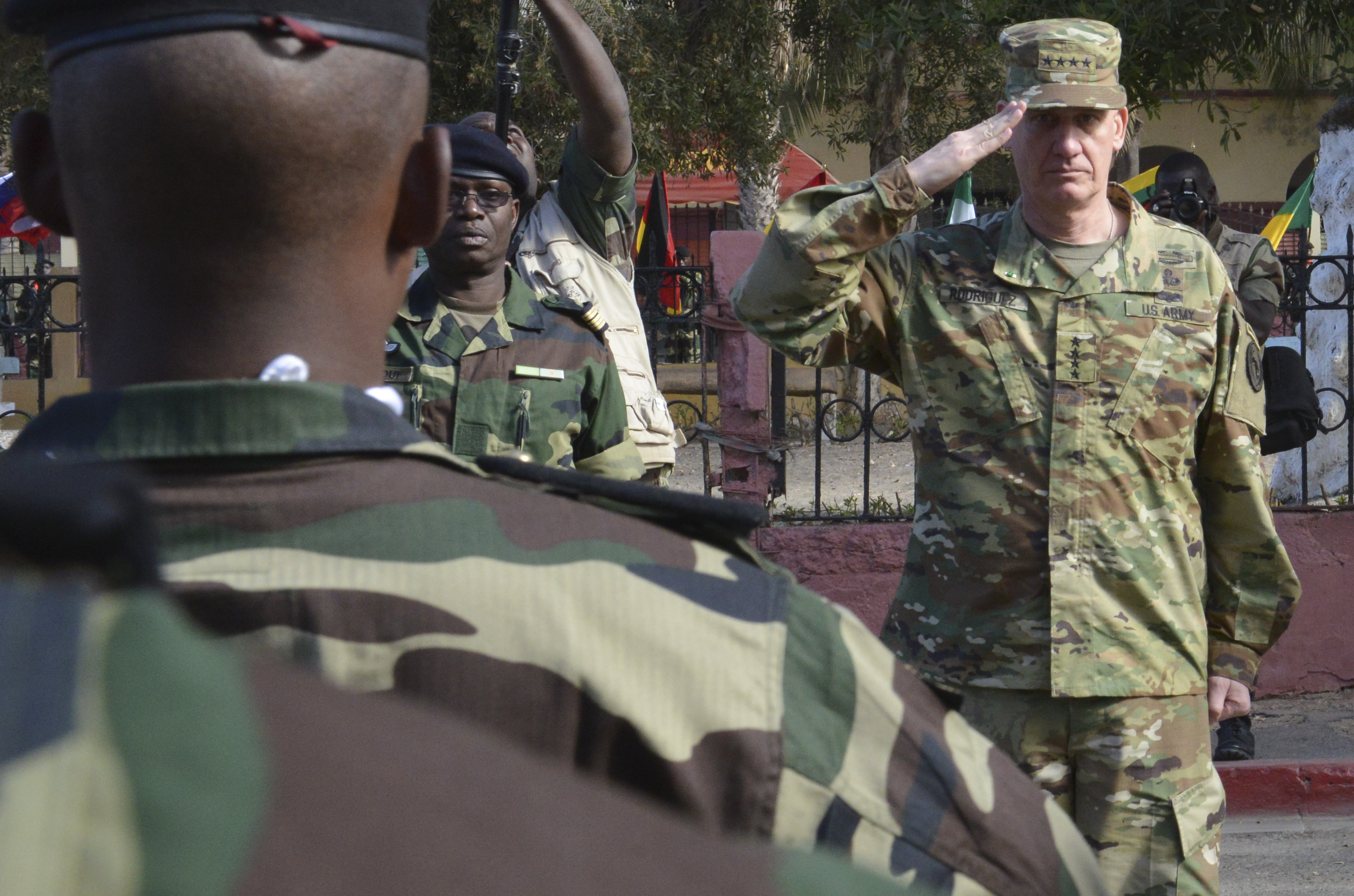 U.S. Army Gen. David Rodriguez, commander of U.S. Africa Command, salutes a formation of Senegalese Soldiers during the closing ceremony for Flintlock 2016 in St. Louis, Senegal, Feb. 29, 2016. Flintlock, sponsored by U.S. Africa Command, is an annual exercise designed to increase interoperability among multinational Special Operations Forces. (Photo by U.S. Army Staff Sgt. Christopher Klutts, U.S. Africa Command)