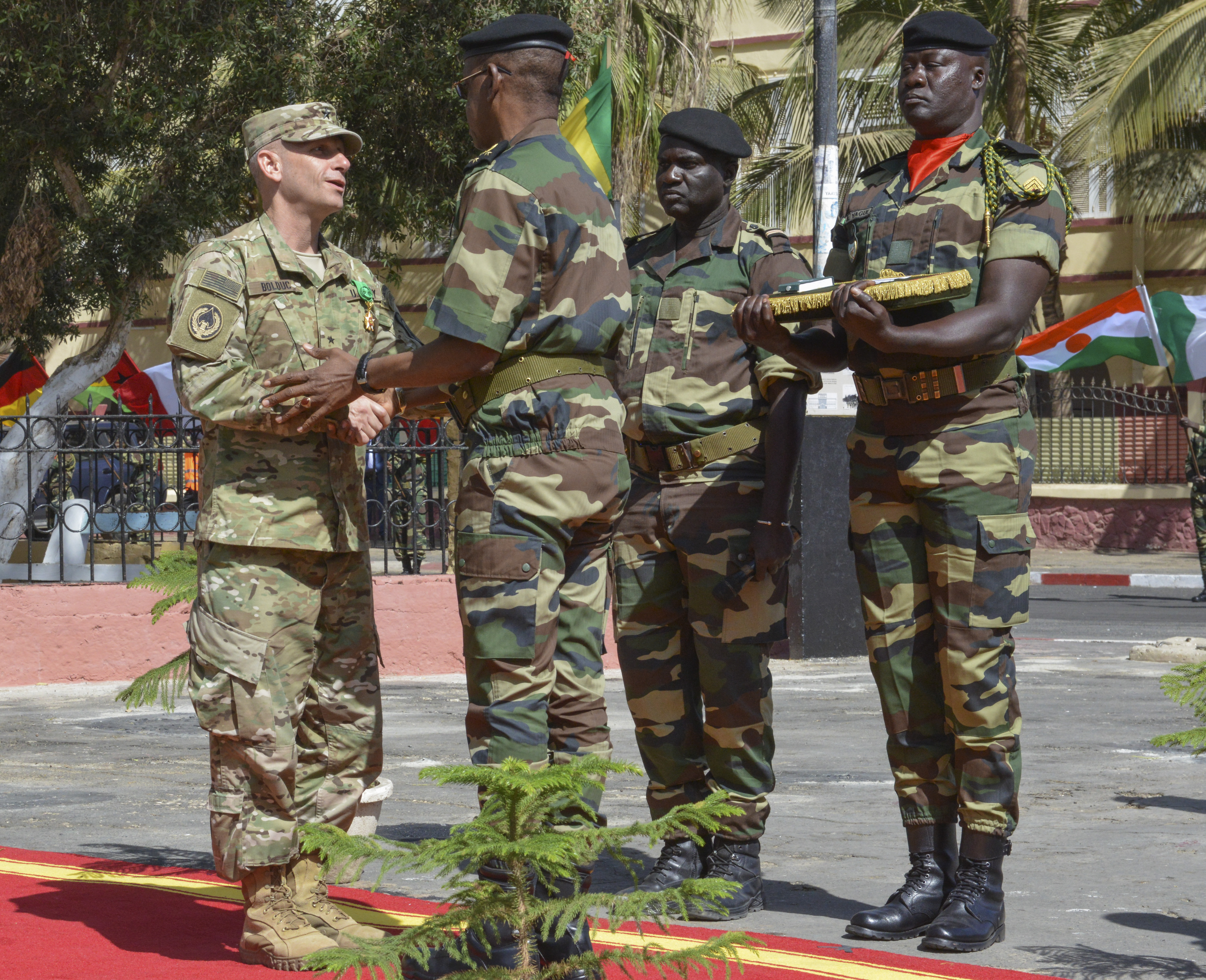 U.S. Army Brig. Gen. Donald C. Bolduc, Special Operations Command-Africa commander, shakes hands with Senegal Army Maj. Gen. Mamadou Sow, chief of general staff, after being inducted into the Senegal National Order of the Lion as part of the closing ceremony for Flintlock 2016 in St. Louis, Senegal, Feb. 29, 2016. The National Order of the Lion is the highest category of Senegal's military awards.
