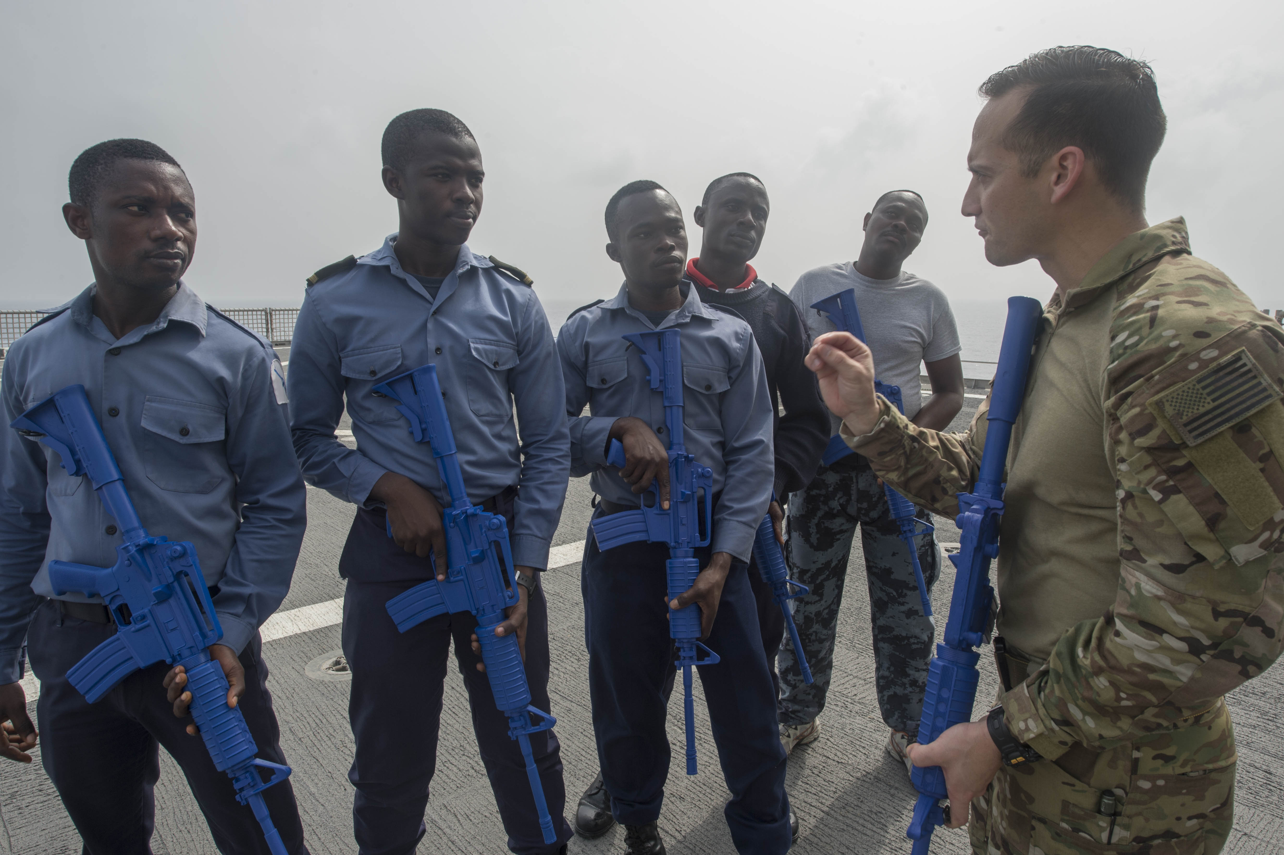 Machinery Technician 2nd Class Paul Avella, a U.S. Coast Guard Tactical Law Enforcement Detachment member, conducts tactical procedures training with the Ghanaian combined boarding team members aboard USNS Spearhead (T-EPF 1) Feb. 10, 2016. The Military Sealift Command expeditionary fast transport vessel USNS Spearhead is on a scheduled deployment in the U.S. 6th Fleet area of operations to support the international collaborative capacity-building program Africa Partnership Station. (U.S. Navy photo by Mass Communication Specialist 3rd Class Amy M. Ressler/Released)