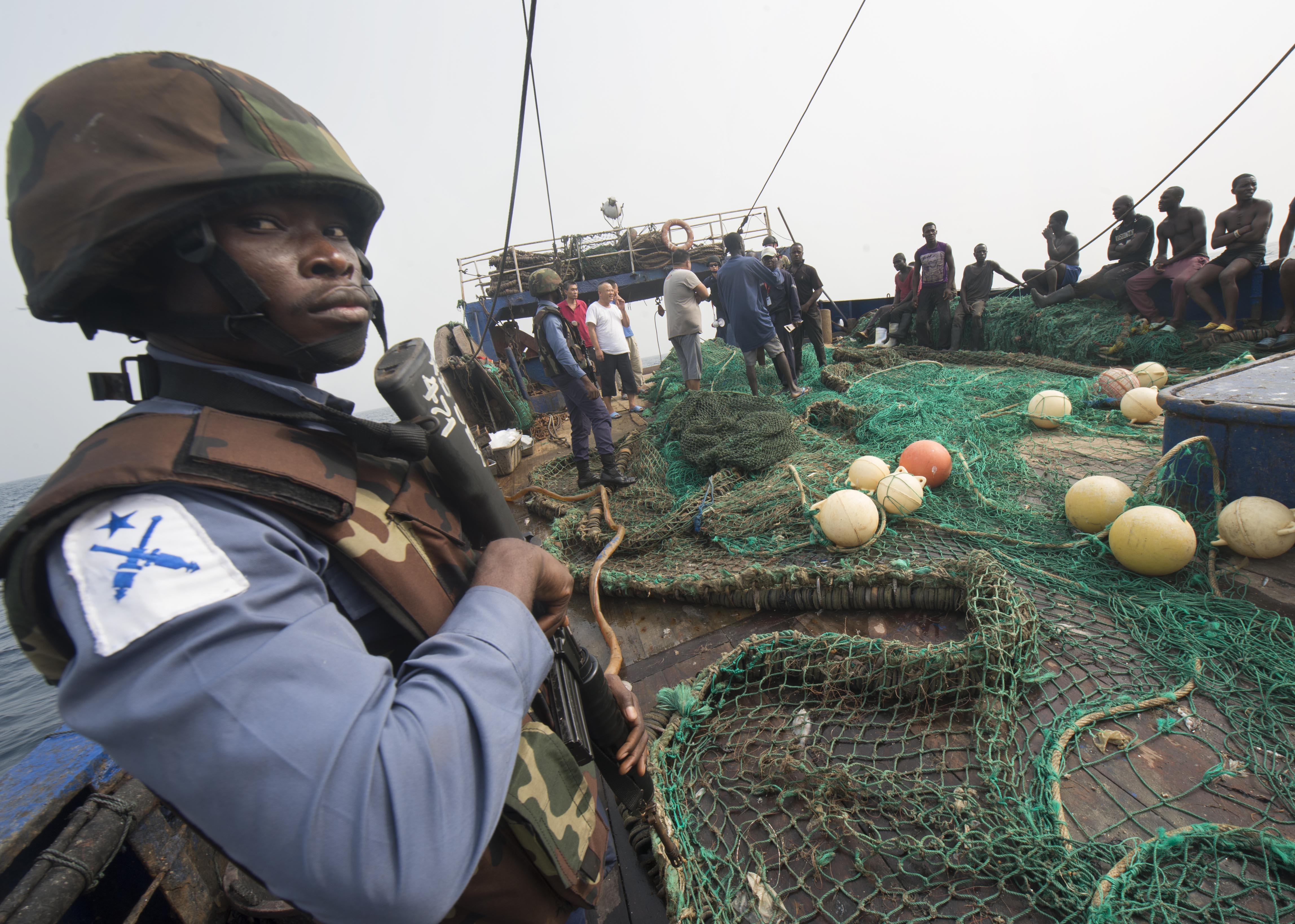 (Feb. 6, 2016) - A member of the Ghanaian Navy stands aboard a fishing vessel during a combined joint boarding operation Feb. 6, 2016. The Military Sealift Command expeditionary fast transport vessel USNS Spearhead (T-EPF 1) is on a scheduled deployment to the U.S. 6th Fleet area of operations to support the international collaborative capacity-building program Africa Partnership Station.