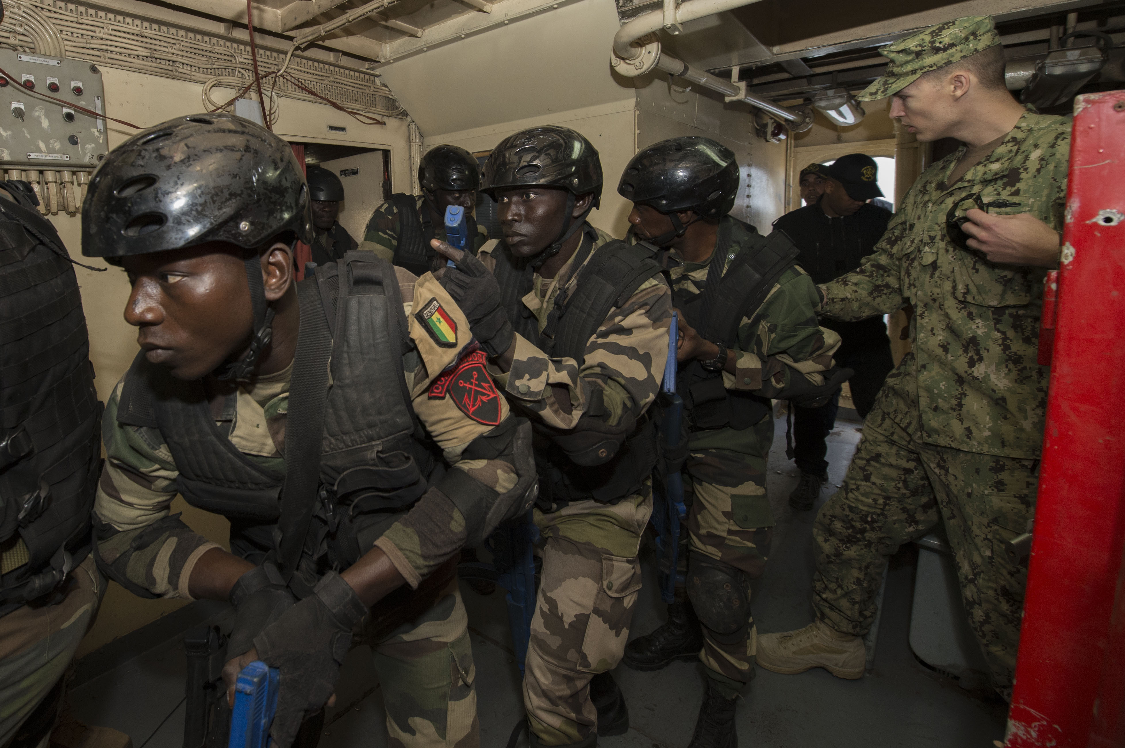 160315-N-ZE250-049 DAKAR, Senegal (March 15, 2016) U.S. Navy and Senegalese navy sailors conduct visit, board, search and seizure training aboard the Senegalese naval vessel PHM Njambuur during Obangame/Saharan Express 2016 (OESE16) in Dakar, Senegal, March 15, 2016. OESE16, one of three African regional express series exercises facilitated by U.S. Naval Forces Europe-Africa/U.S. 6th Fleet, seeks to increase regional cooperation, maritime domain awareness, information sharing practices and improve interoperability among participating forces in order to enhance maritime security and regional economic stability. (U.S. Navy photo by Mass Communication Specialist 3rd Class Weston Jones/Released)