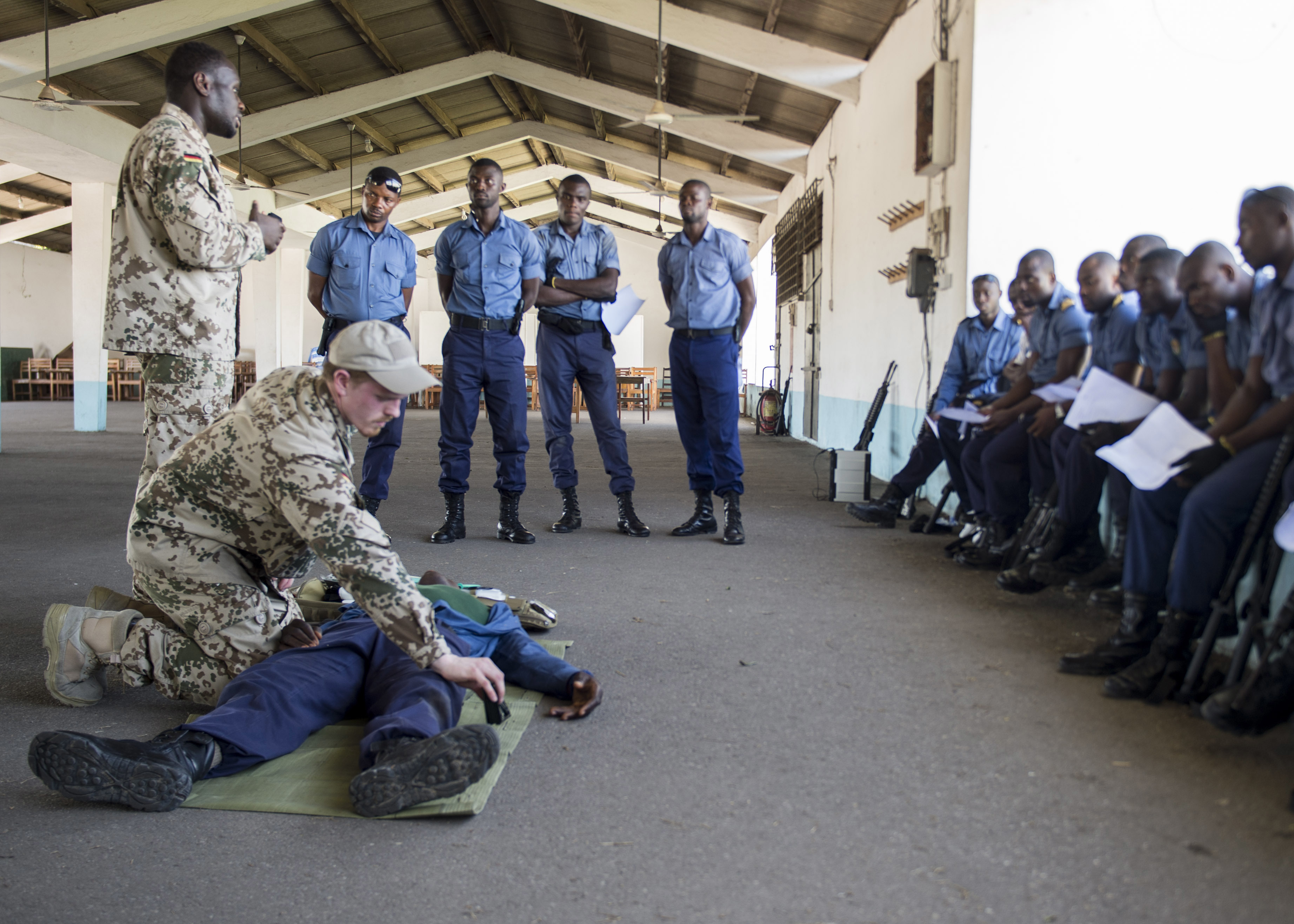 SEKONDI, Ghana (March 15, 2016) - German navy maritime interdiction operations  team members brief Ghanaian Navy Sailors on combat first-aid on the Sekondi Naval Base as part of a work-up to Exercise Obangame/Saharan Express 2016, March 15.  Obangame/Saharan Express, one of three African regional express series exercises facilitated by U.S. Naval Forces Europe-Africa/U.S. 6th Fleet, seeks to increase regional cooperation, maritime domain awareness, information sharing practices and improve interoperability among participating forces in order to enhance maritime security and regional economic stability. (U.S. Navy photo by Mass Communication Specialist 2nd Class Luis R. Chavez Jr/Released)