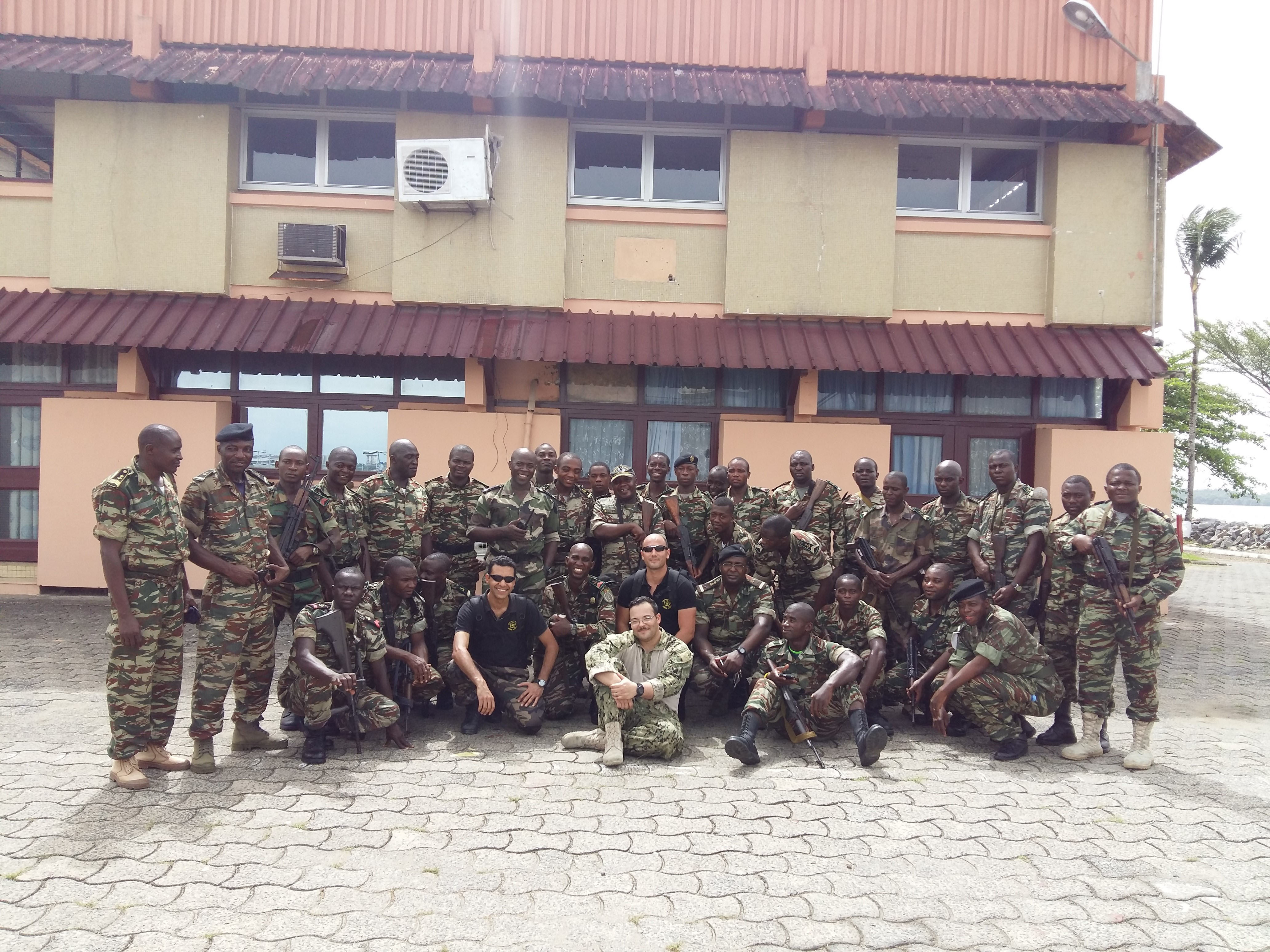 160317-A-RU135-001 DOUALA, Cameroon (March 17, 2016) Members of the Cameroonian navy pose with their U.S. and Moroccan counterparts in Douala, Cameroon, after a day of training together on medical scenarios and maritime interdiction operations during exercise Obangame/Saharan Express 2016. Obangame/Saharan Express, one of three African regional express series exercises facilitated by U.S. Naval Forces Europe-Africa/U.S. 6th Fleet, seeks to increase regional cooperation, maritime domain awareness, information sharing practices and improve interoperability among participating forces in order to enhance maritime security and regional economic stability. (U.S. Navy photo by Meghan Henderson/Released)