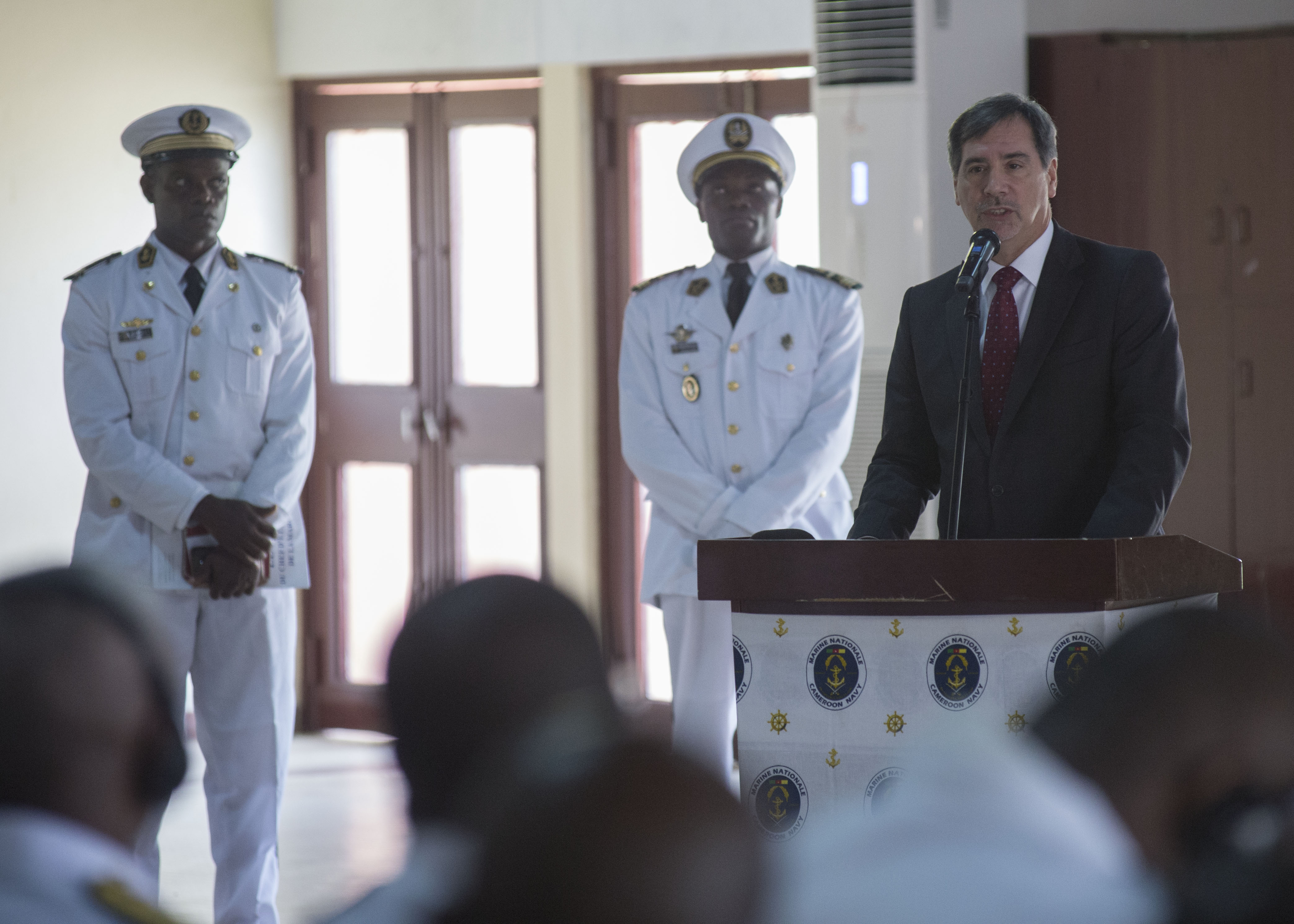 160325-N-QF605-118 DOUALA, Cameroon (March 25, 2016) - U.S. Ambassador to Cameroon, Michael S. Hoza, speaks during the Exercise Obangame/Saharan Express 2016 closing ceremony in Douala, Cameroon, March 25, 2016. Obangame/Saharan Express, one of three African regional express series exercises facilitated by U.S. Naval Forces Europe-Africa/U.S. 6th Fleet, seeks to increase regional cooperation, maritime domain awareness, information sharing practices and improve interoperability among participating forces in order to enhance maritime security and regional economic stability. (U.S. Navy photo by Mass Communication Specialist 1st Class Amanda Dunford/Released)