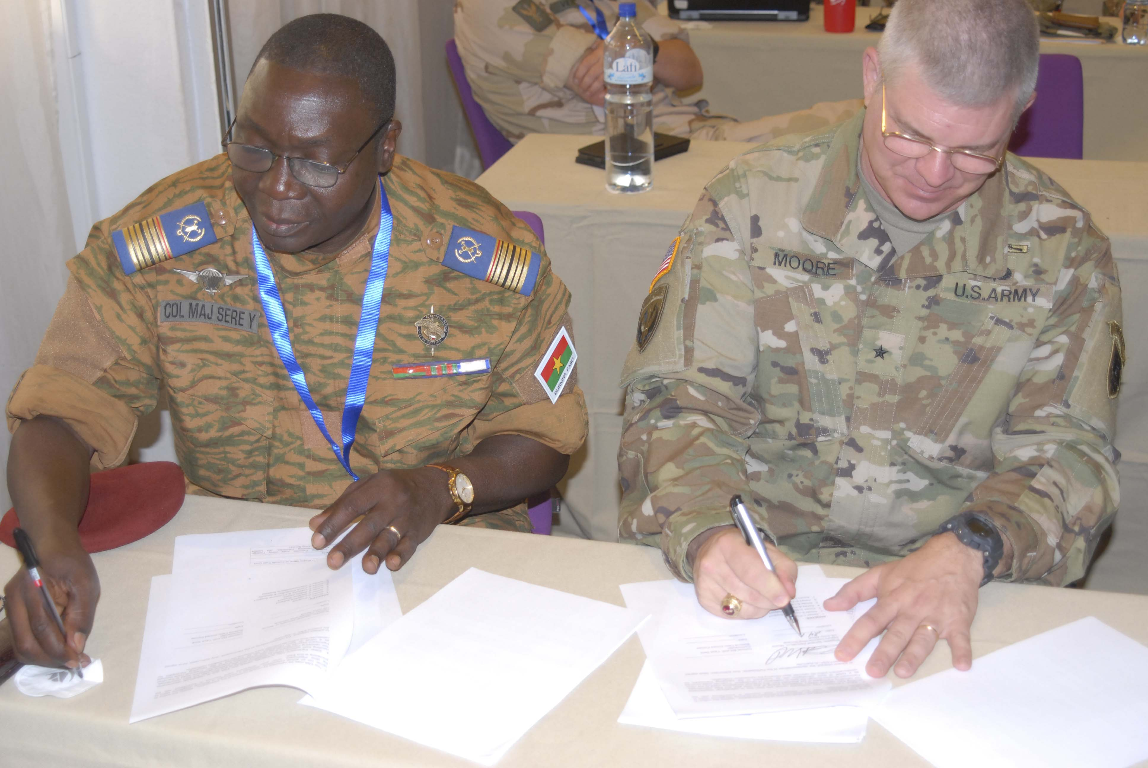 Brig. Gen. Kenneth H. Moore, Jr., U.S. Army Africa deputy commanding general and Col. Maj. Yaya Sere, chief planning officer and chief of operations for the General Staff of the Burkina Faso Armed Forces sign the Western Accord 2016 Exercise Support Arrangement between USARAF and The Ministry of Defence of Burkina Faso. WA 2016 is a two-week long exercise with regional African partners and their Western allies designed to strengthen partnerships and enhance capacity and capabilities to conduct joint multinational peacekeeping operations in West Africa. (U.S. Army Africa photo by Sgt. 1st Class Chris Bridson)