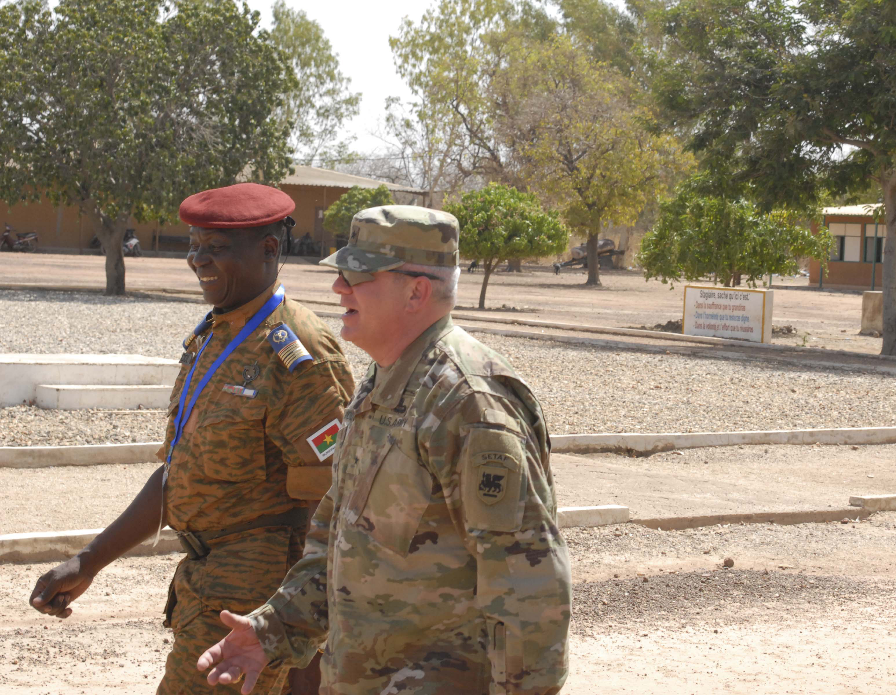 Brig. Gen. Kenneth H. Moore, Jr., U.S. Army Africa deputy commanding general and Col. Maj. Yaya Sere, chief planning officer and chief of operations for the General Staff of the Burkina Faso Armed Forces take a guided tour of the Western Accord 2016 training site at the BFAF Noncommissioned Officer Academy March 22. WA 16 is a two-week long exercise with regional African partners and their Western allies designed to strengthen partnerships and enhance capacity and capabilities to conduct joint multinational peacekeeping operations in West Africa. (U.S. Army Africa photo by Sgt. 1st Class Chris Bridson)