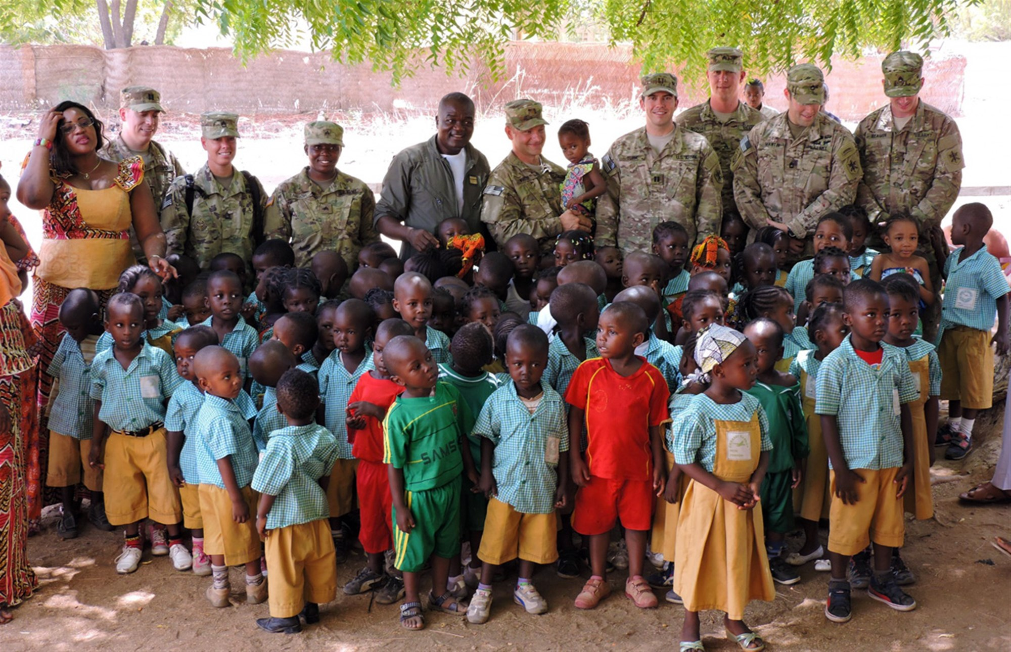 Soldiers from 2nd Infantry Brigade Combat Team, 3rd Infantry Division stationed in Garoua, Cameroon, present school supplies purchased with Spirit of America funding to the Cameroon Air Base 301 Pre-School on April 8. Soldiers from 3rd Inf. Div. provide non-lethal support to their Cameroonian hosts as part of U.S. Africa Command. (U.S. Army Africa photo by Spc. Jonathan Singletary/Released)