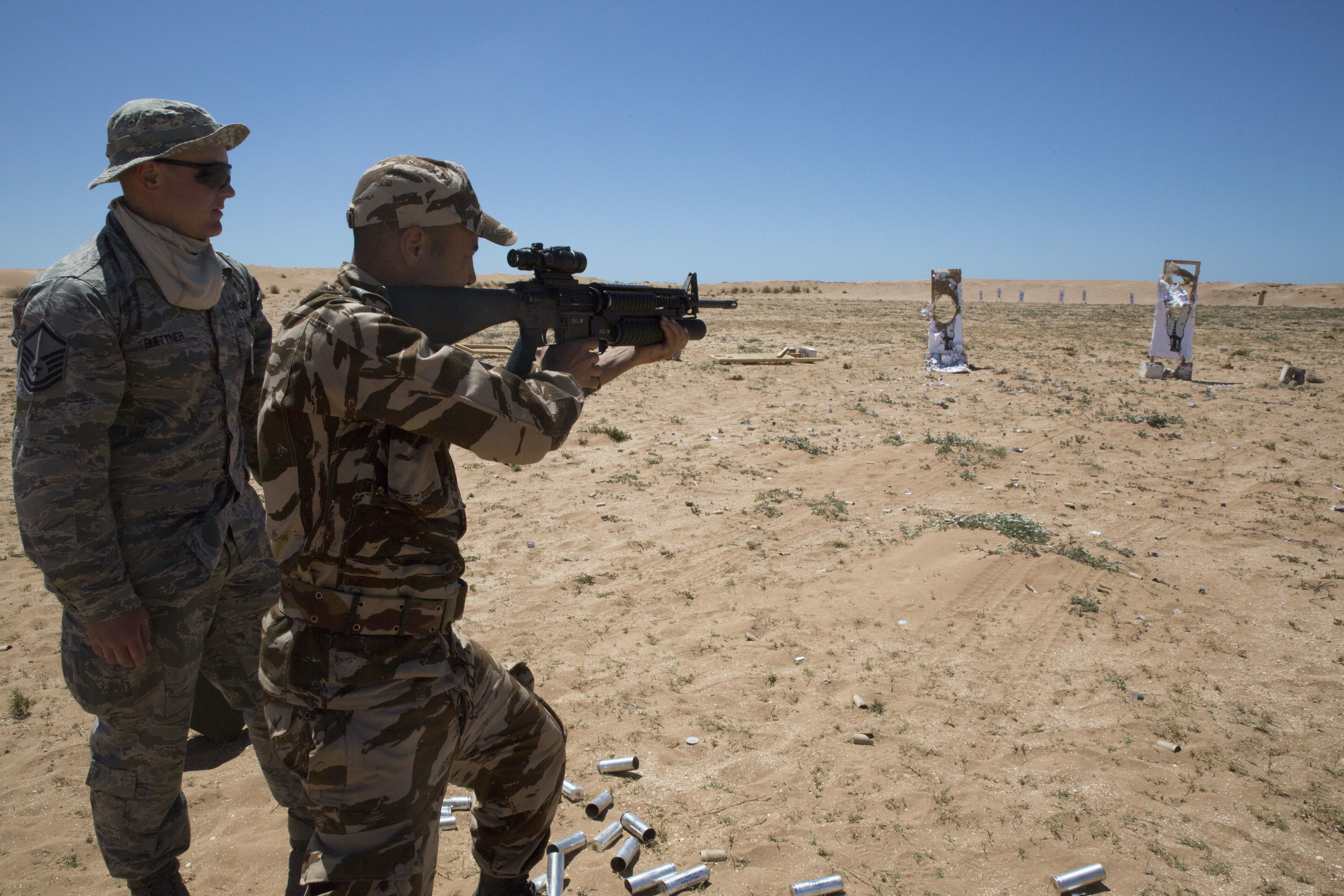 Service members from the Royal Moroccan Armed Forces practice firing the M203 grenade launcher during Exercise African Lion 16, April 19, 2016 aboard the Tifnit Military Base in Morocco. African Lion is an annually-scheduled, combined U.S.-Moroccan exercise designed to improve interoperability and mutual understanding of each nation's tactics, techniques and procedures while demonstrating the strong bond between the two nations' militaries.  The exercise is scheduled to run through late April 2016.  (U.S. Marine Corps photo by Lance Cpl. Melissa Martens/Released)