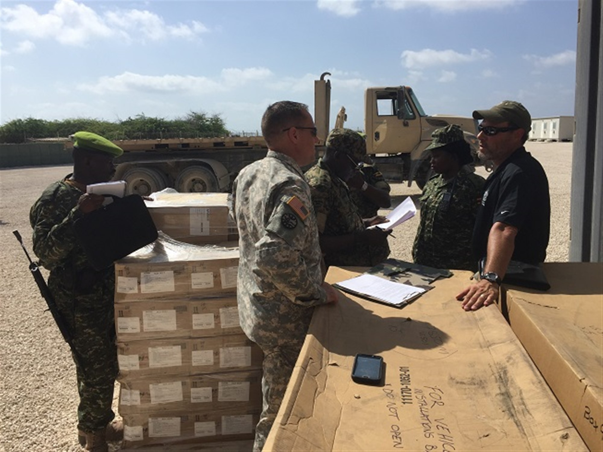 Members of the Uganda People's Defense Force take ownership of communications equipment delivered to them from the U.S. Army to be used in their support to the African Union Mission in Somalia.