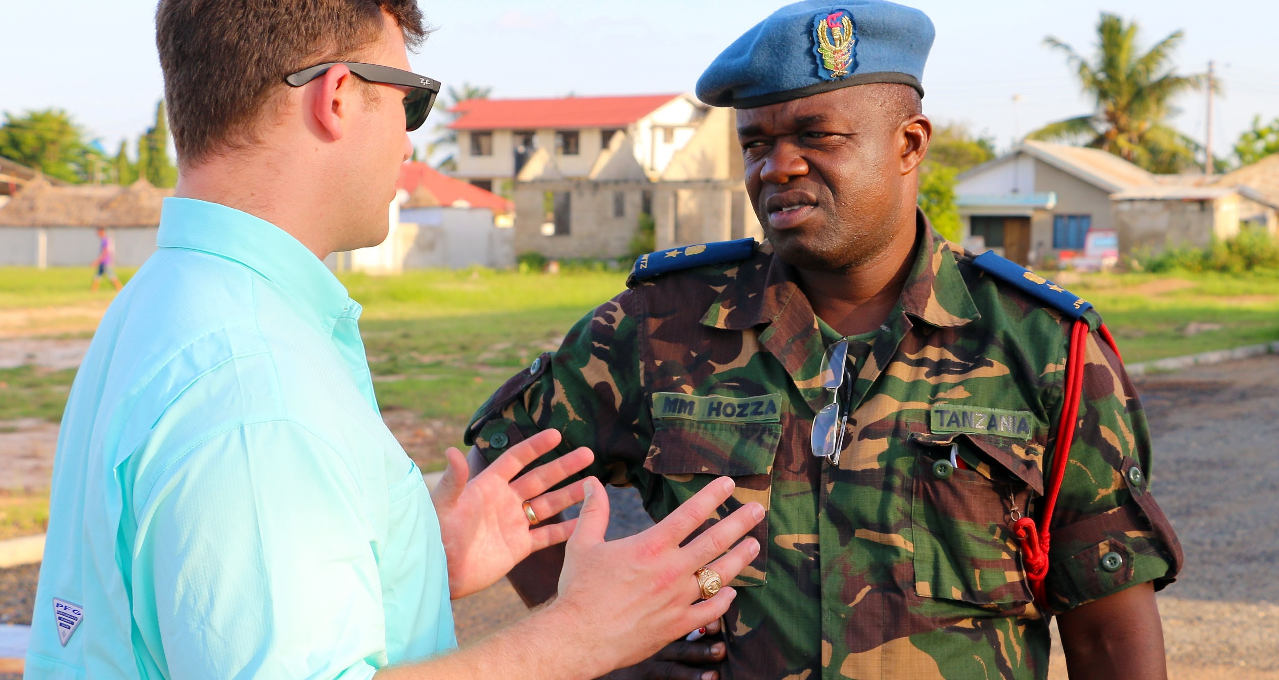 Capt. Bryan Neal, operations planner for 1st Battalion, 9th Field Artillery Regiment, 2nd Brigade Combat Team, 3rd Infantry Division, discusses training priorities for exercise Eastern Accord 2016 with Lt. Col. Hozza, a Tanzanian People's Defense Force officer, during the final planning event site visit to the Tanzanian Peacekeeping Training Center in Dar es Salaam, Tanzania, May 3. Soldiers of 1-9 FA are supporting EA 2016 this summer as part of the regionally allocated force for U.S. Army Africa and U.S. Africa Command. (U.S. Army Africa photo by Capt. Jarrod Morris)