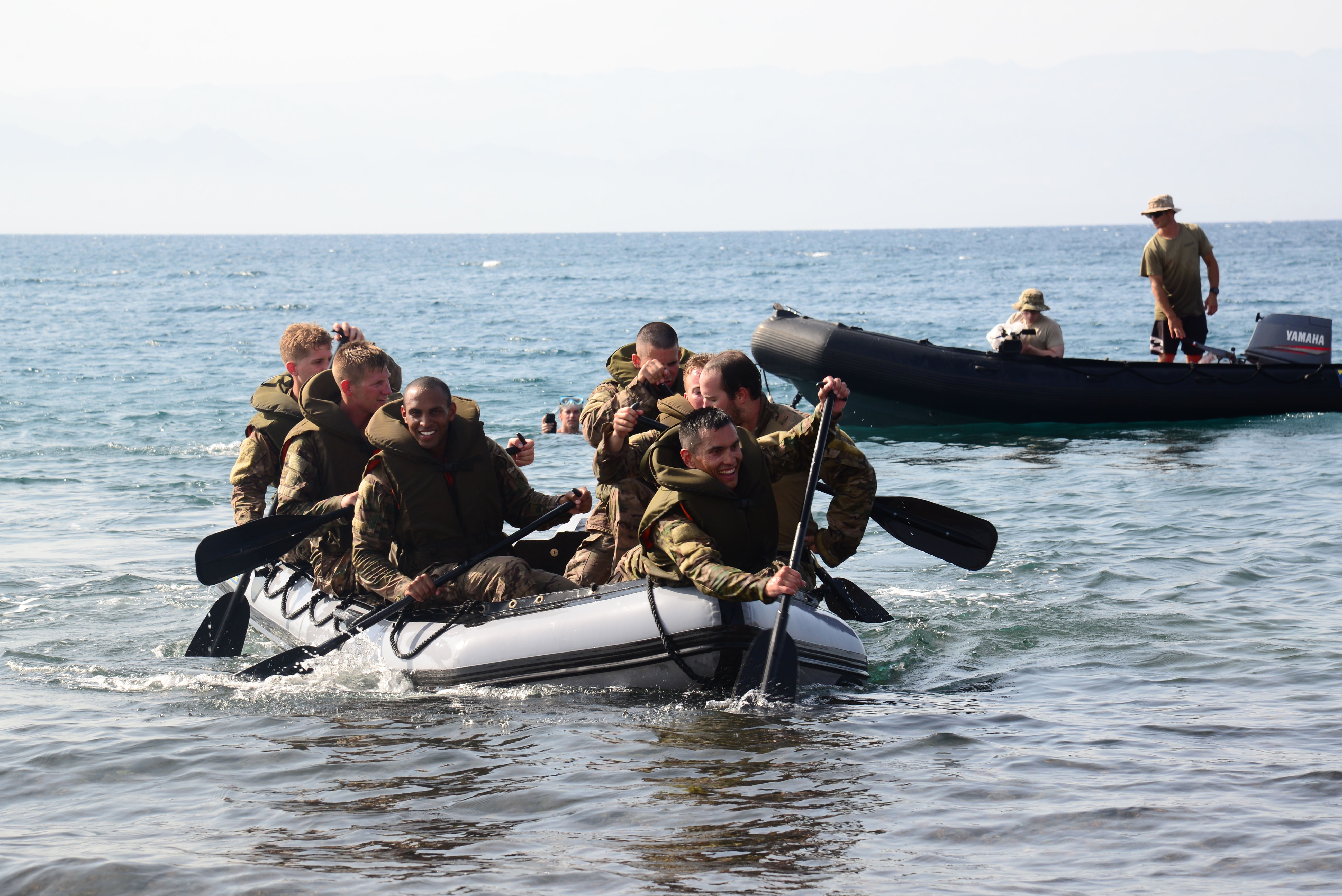 U.S. Army soldiers from the 2nd Battalion, 124th Infantry Regiment, paddle a zodiac watercraft across a beach during a water crossing exercise May 5, 2016, at Arta Plage, Djibouti. The soldiers completed the exercise as a team in less than 40 minutes. (U.S. Air Force photo by Senior Airman Benjamin Raughton/Released)