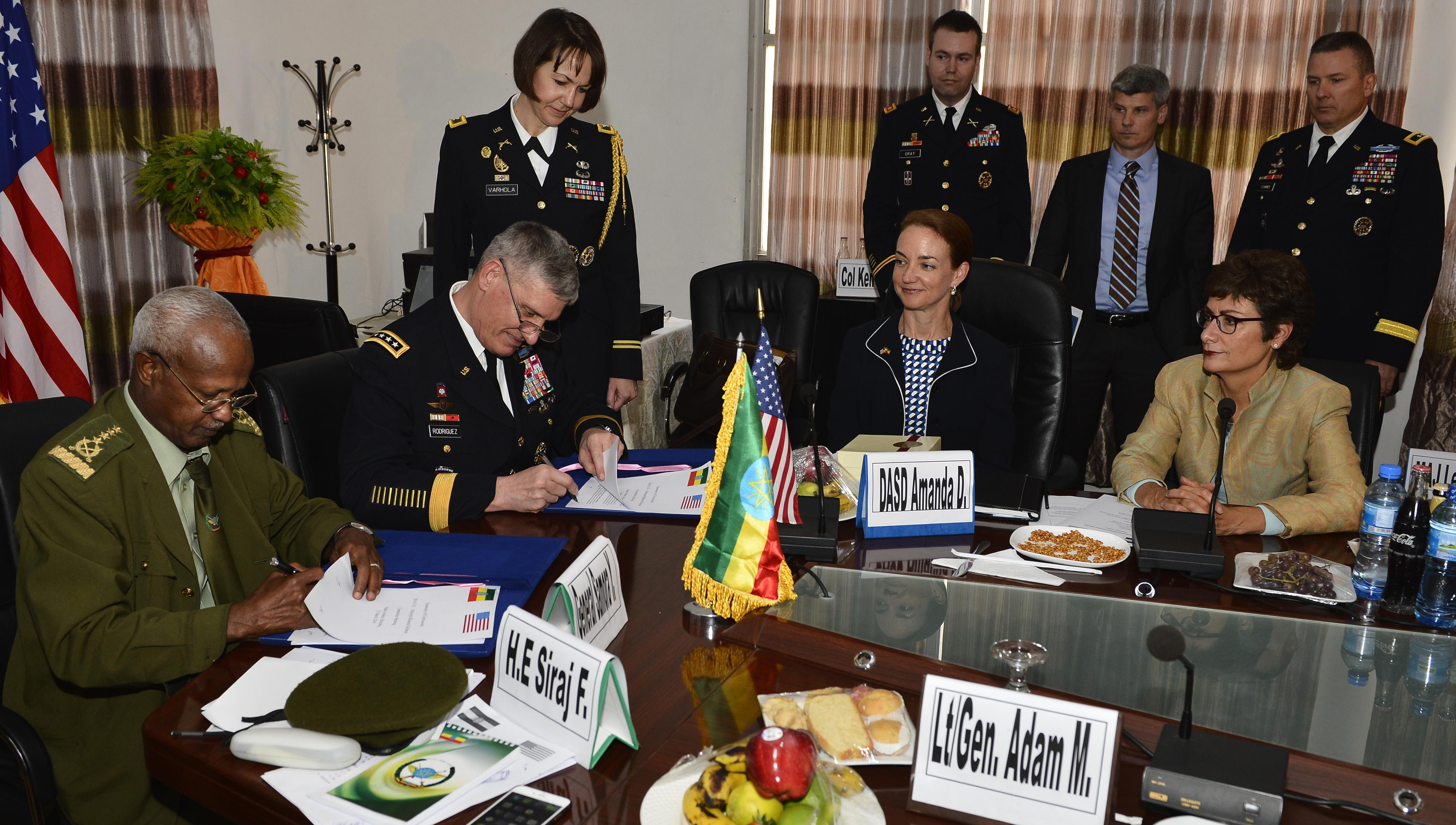 Gen. David Rodriguez, Commander U.S. Africa Command and en. Samora Yunis, Chief of Staff Ethiopian National Defense Force sign the summary of conclusions after a Bilateral Defense Committee (BDC) meeting in Addis Ababa, Ethiopia, March 31, 2016. The new agreement out lines the cross-exchange of logistics, services, supplies and support, as well as a way forward for the Africa Data-Sharing Network and combat engineering. (U.S. Air Force photo by Tech. Sgt. Dan DeCook)