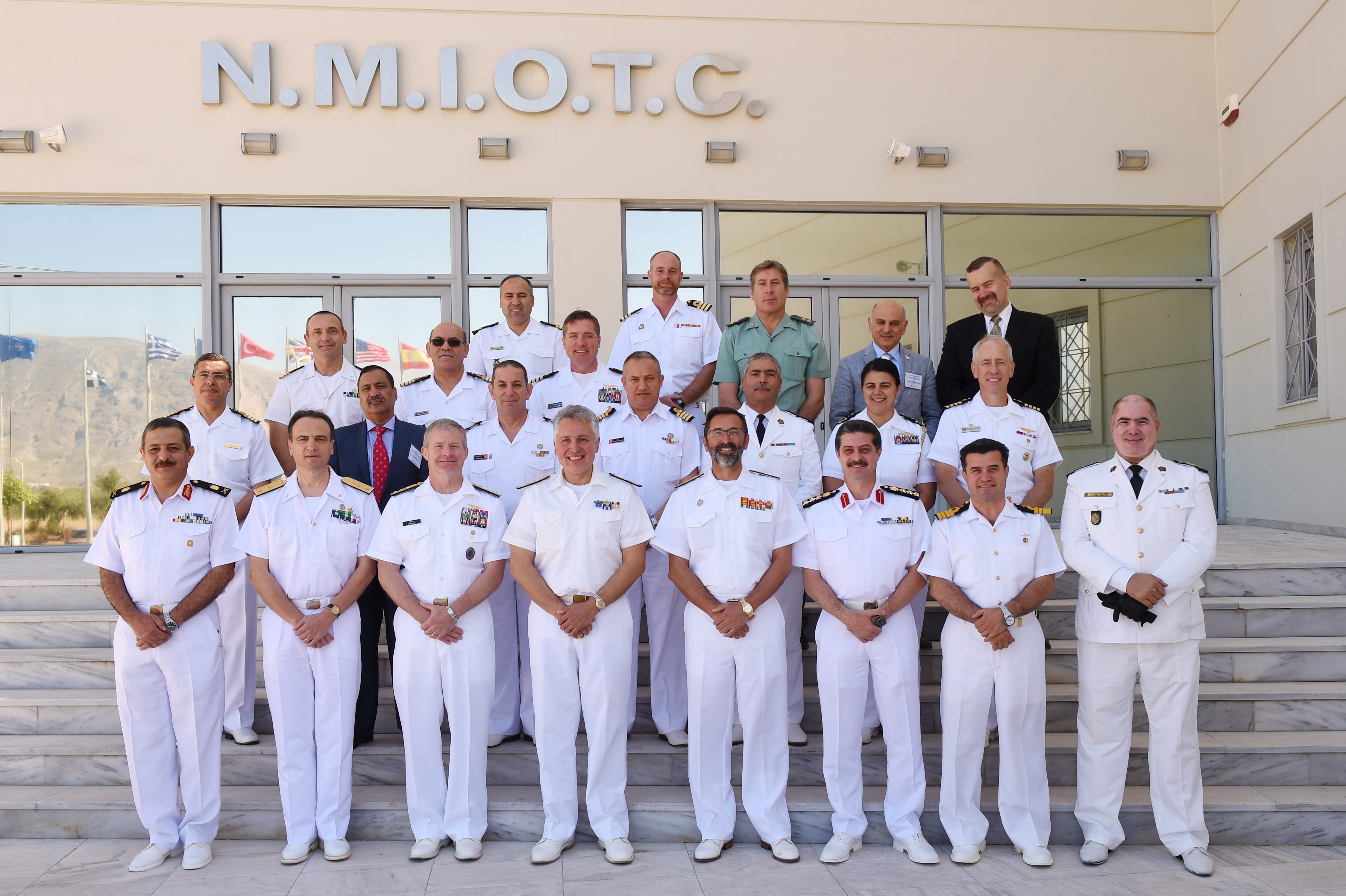 160517-N-XT273-424 SOUDA BAY, Greece (May 17, 2016) Senior leaders from North Africa, Europe and the U.S. pose for a group photo in front of the NATO Maritime Interdiction Operational Training Center after the Exercise Phoenix Express 2016 opening ceremony May 17. Phoenix Express 2016, sponsored and facilitated by U.S Africa Command, is designed to improve regional cooperation, increase maritime domain awareness, information-sharing practices, and operational capabilities to enhance efforts to achieve safety and security in the Mediterranean Sea. (U.S. Navy photo by Mass Communication Specialist 2nd Class Justin Stumberg/Released)