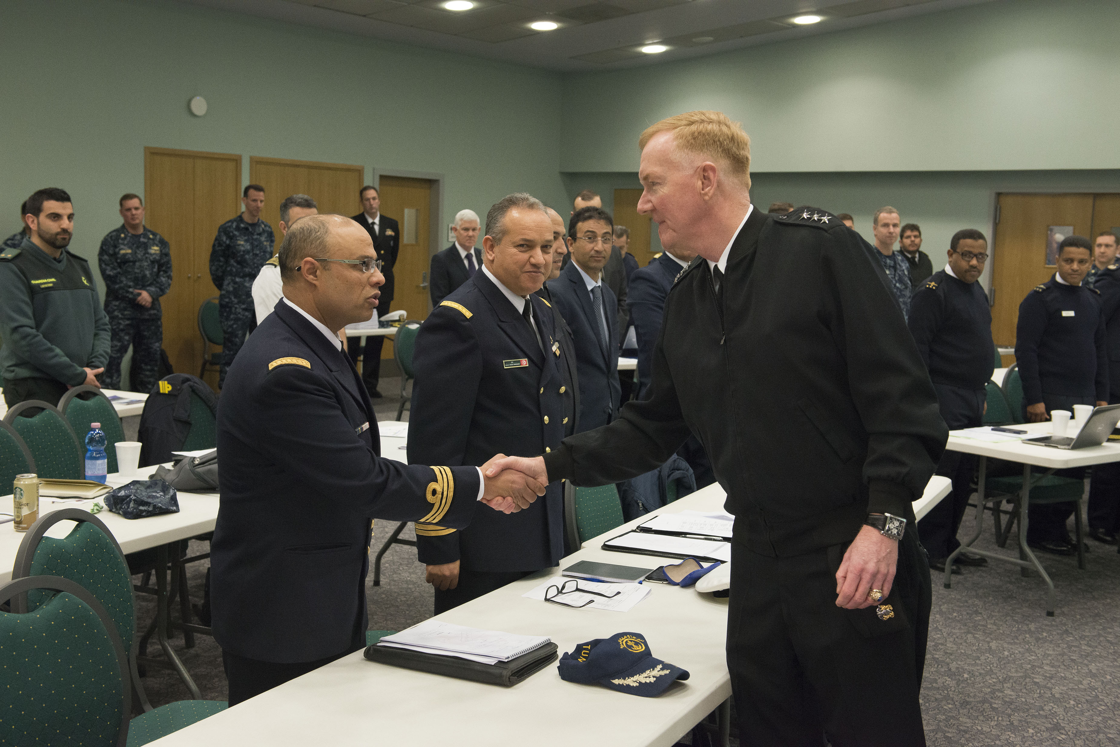 160307-N-OX801-025 NAVAL SUPPORT ACTIVITY NAPLES, Italy (March 7, 2016) Commander, U.S. 6th Fleet, Vice Adm. James Foggo III, right, welcomes attending senior leaders from maritime forces at the Phoenix Express 2016 planning conference at Naval Support Activity Naples, Italy, March 7, 2016. U.S. 6th Fleet, headquartered in Naples, Italy, conducts the full spectrum of joint and naval operations, often in concert with allied, joint, and interagency partner, in order to advance U.S. national interests and security and stability in Europe and Africa. (U.S. Navy photo by Mass Communication Specialist 2nd Class Daniel P. Schumacher/Released)